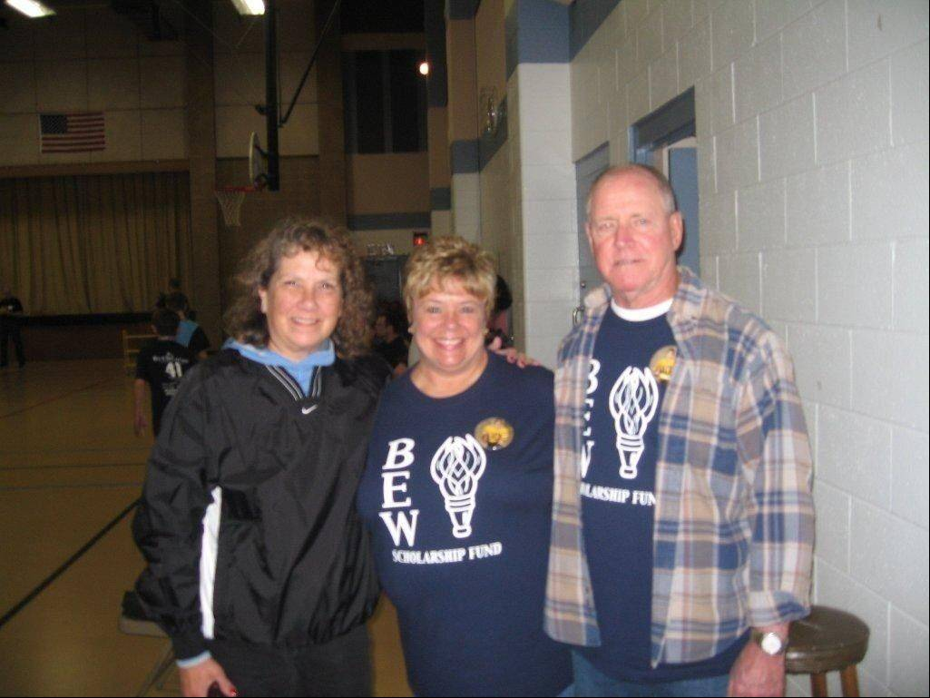 Brian Wagner's mother and stepfather -- Barbara Wagner-Lackey, center, and Ed Lackey -- welcome a supporter at the first Bags for Wags fundraiser. The couple serves as directors on the board of the scholarship fund in Brian's honor.