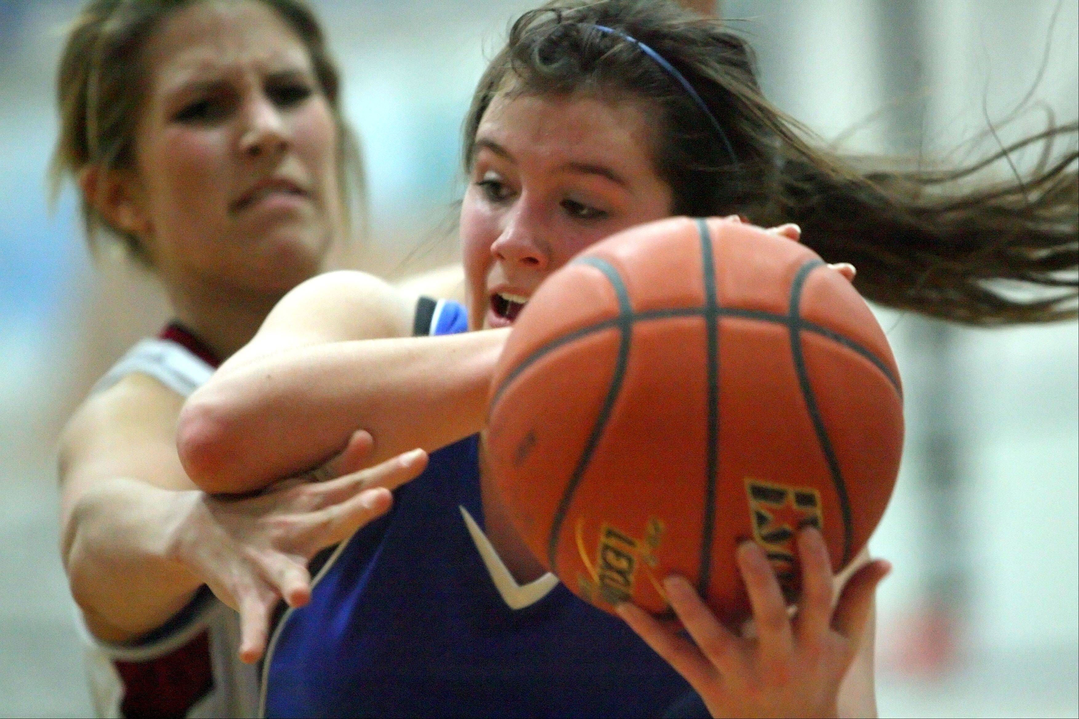 Antioch's Sarah Huebner, left, and Lakes' Nicole Mogged battle for a rebound during their game Tuesday night at Vernon Hills High School.