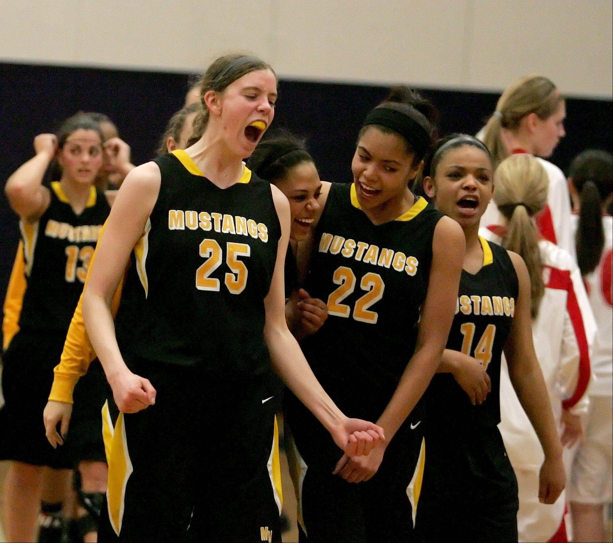 Metea Valley celebrate their win over Naperville Central in Class 4A girls basketball regional action in Oswego on Tuesday.