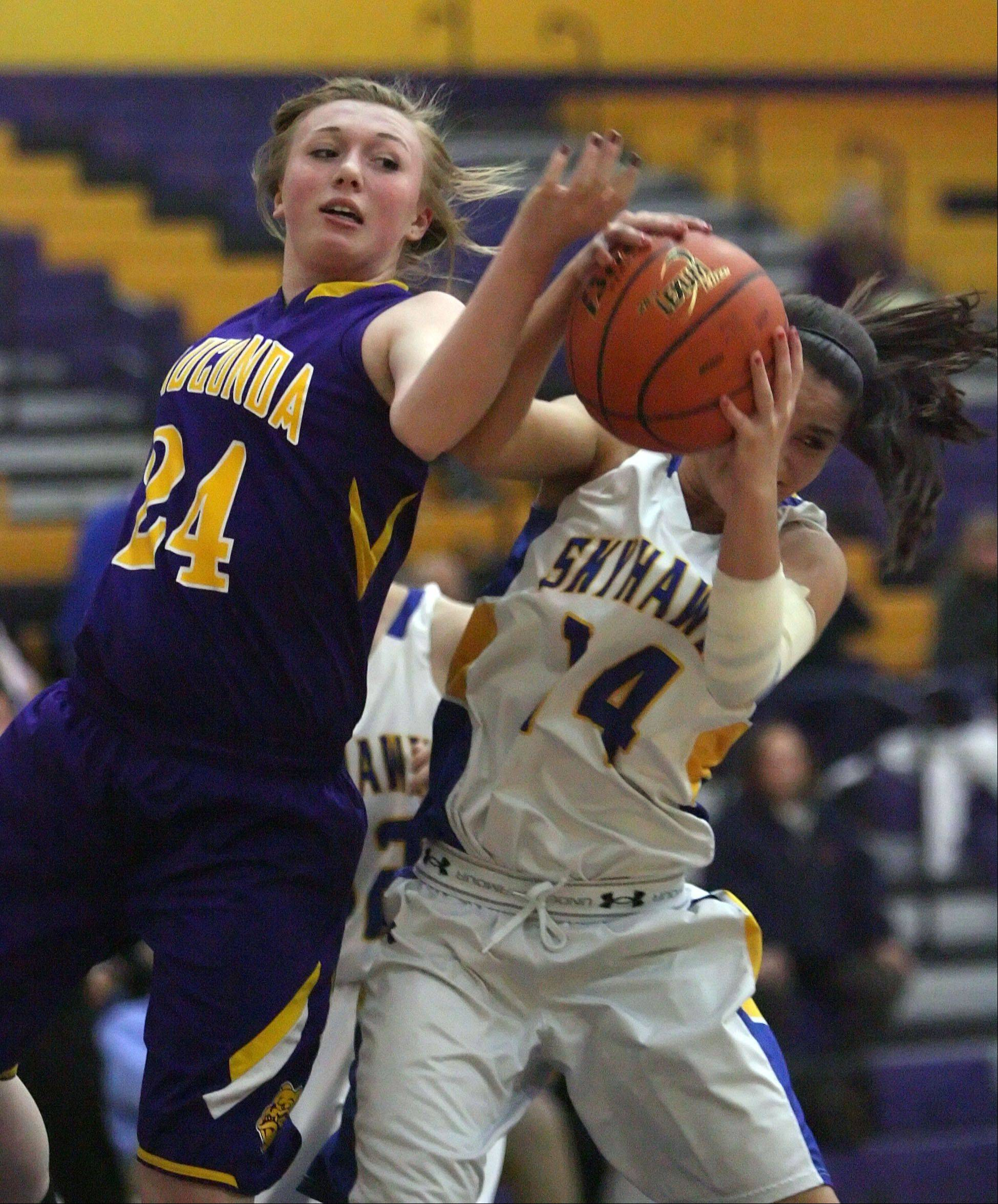 Wauconda's Melissa Latham, left, and Johnsburg's Tayelor Neiss battle for a rebound during Wednesday night's basketball game in Wauconda.