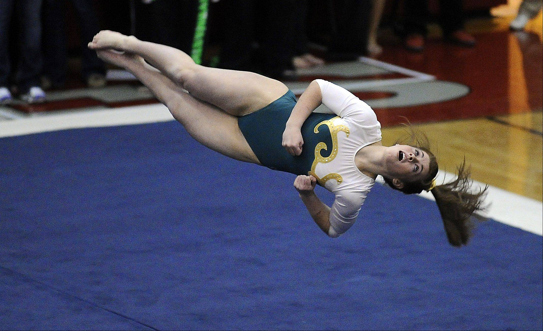 St. Edward's Abby Madden performs her floor routine at the 2012 girls state gymnastics finals at Palatine High School on Friday.
