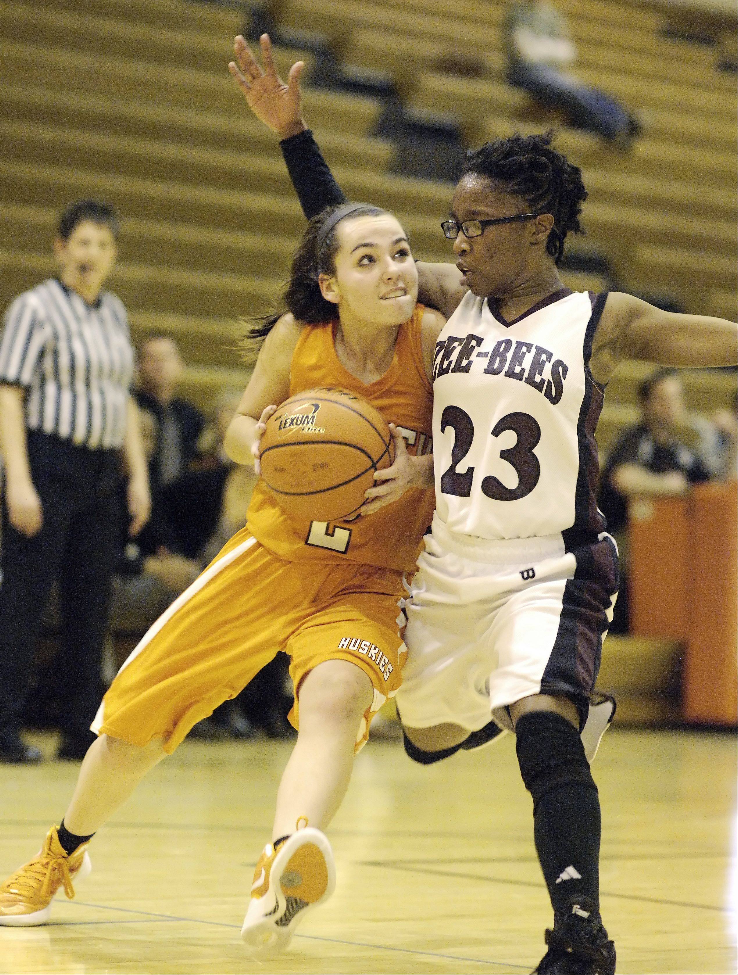 Hersey's Jen Hall makes her way past Zion-Benton's Shania Thompson during Wednesday's regional semifinal at Hersey High School in Arlington Heights.
