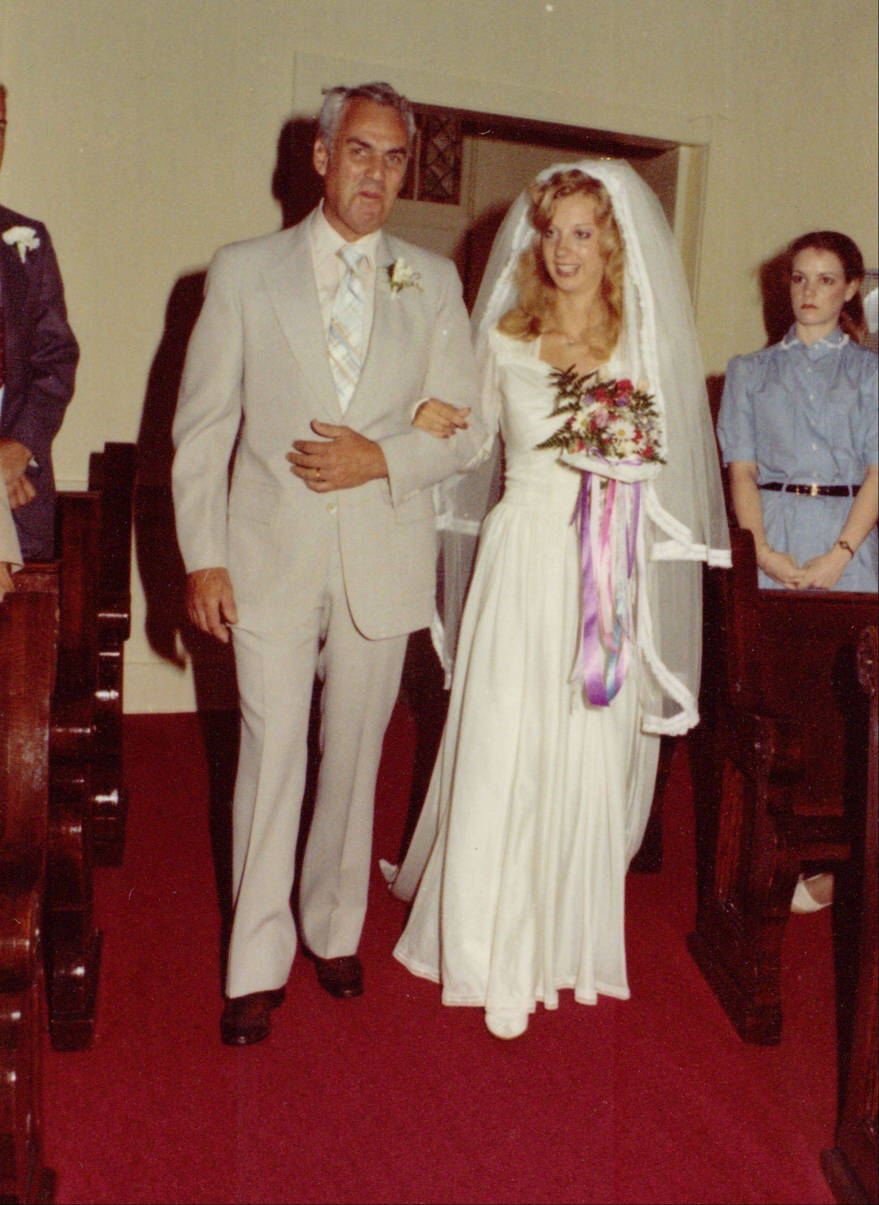 Gene Voiland walks his daughter Ann down the aisle in 1981. Ann wore her mother Cay's dress.
