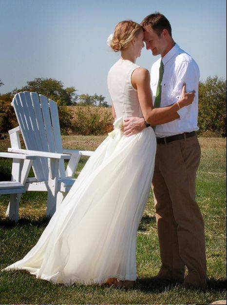 Celeste (Riley) and Greg Brennecka married in October 2011. Celeste wore her grandmother Cay's silk World War II era wedding dress, making it three generations to walk down the aisle in the same gown.