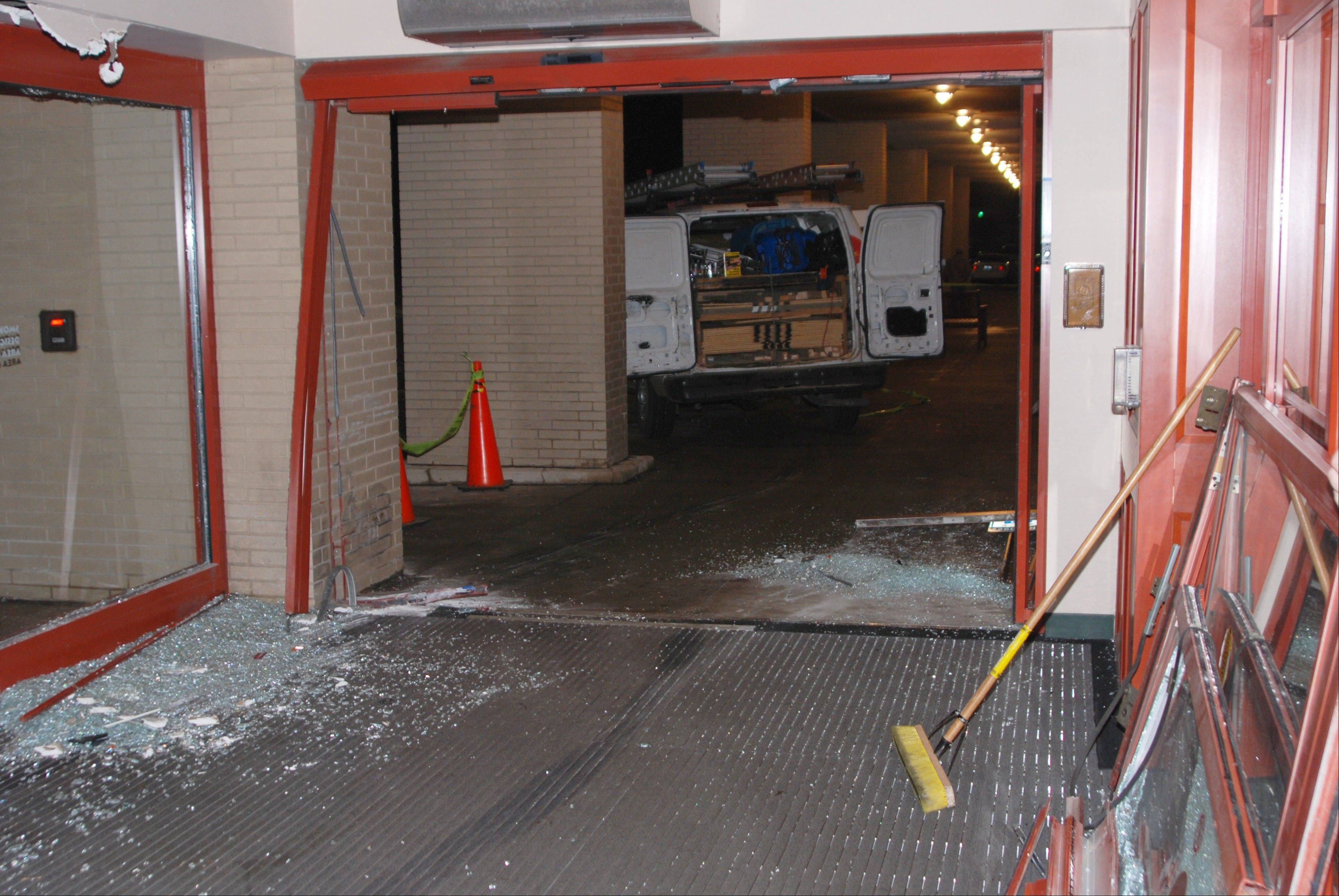 Repairs began Wednesday to the west entrance of the Schaumburg Township District Library building in Schaumburg. The entrance was damaged late Tuesday afternoon when a minivan crashed through the sliding glass doors.