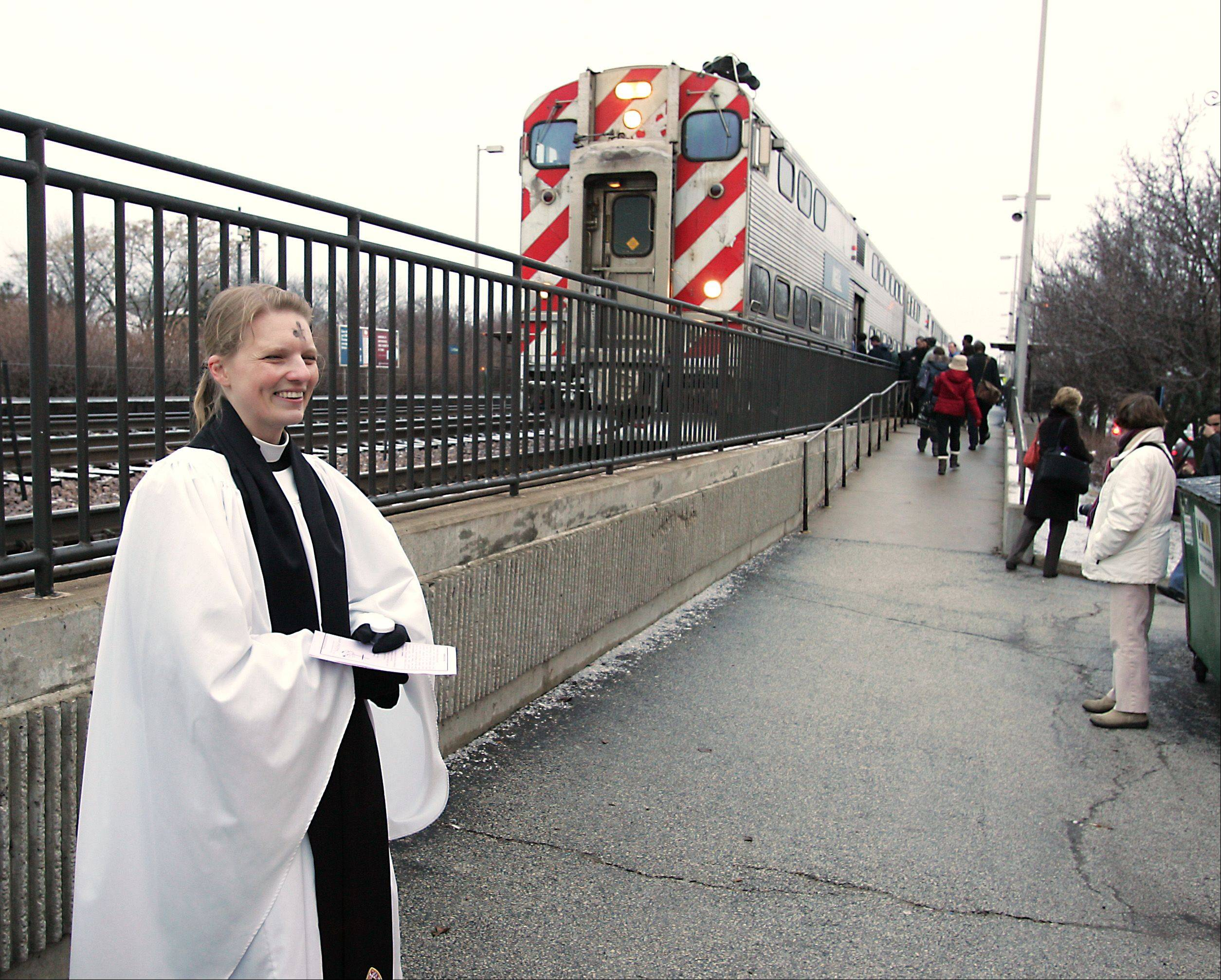 The Rev. Emily Mellott, pastor of Calvary Episcopal Church in Lombard, has become something of a national leader for a movement in the Episcopal Church to offer Ashes to Go for busy people at locations such as train stations and coffee shops. Her team dispensed ashes Wednesday morning for the third year in a row and reached 107 people.