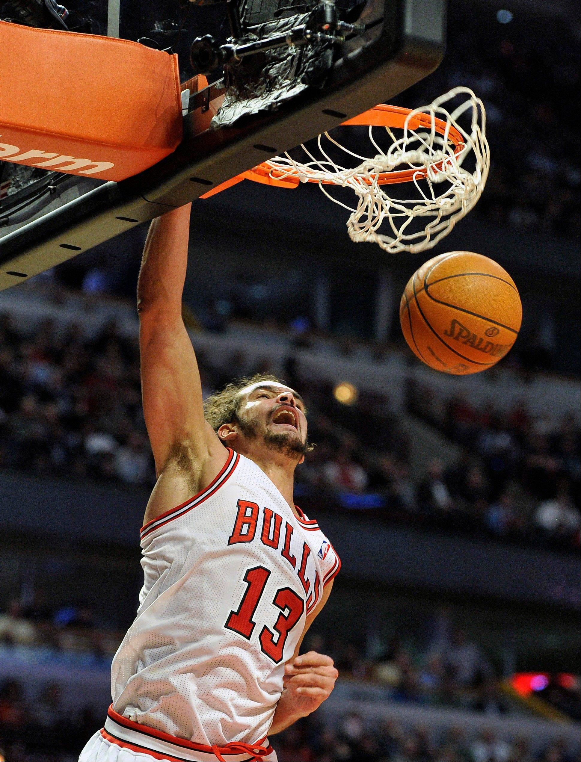 Joakim Noah dunks against the Bucks during the second half Wednesday night. The Bulls center got his first career triple-double in the victory.