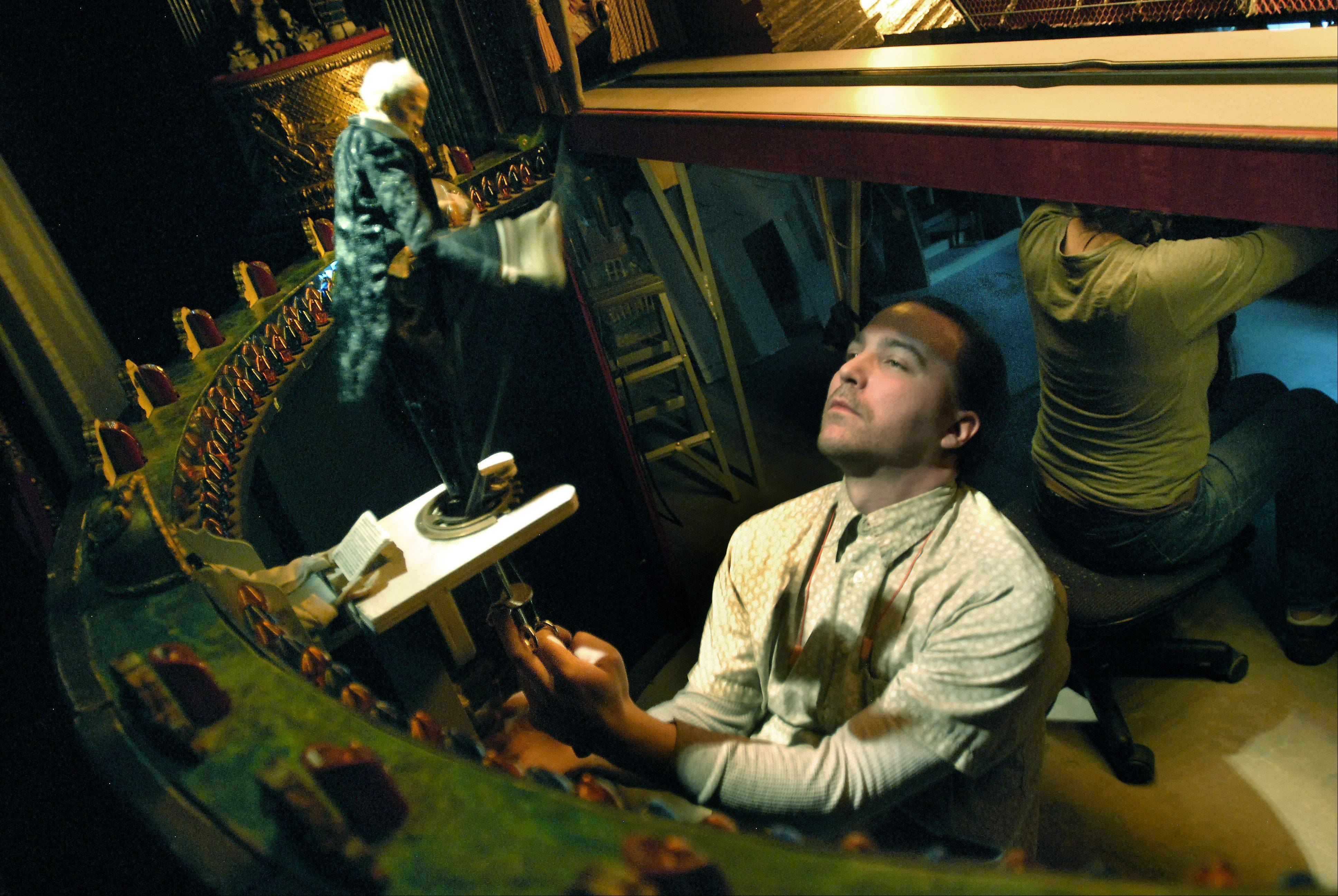 Bill Zars/bzars@dailyherald.com Puppeteer Justin Snyder operates the conductor at Opera in Focus in Rolling Meadows.