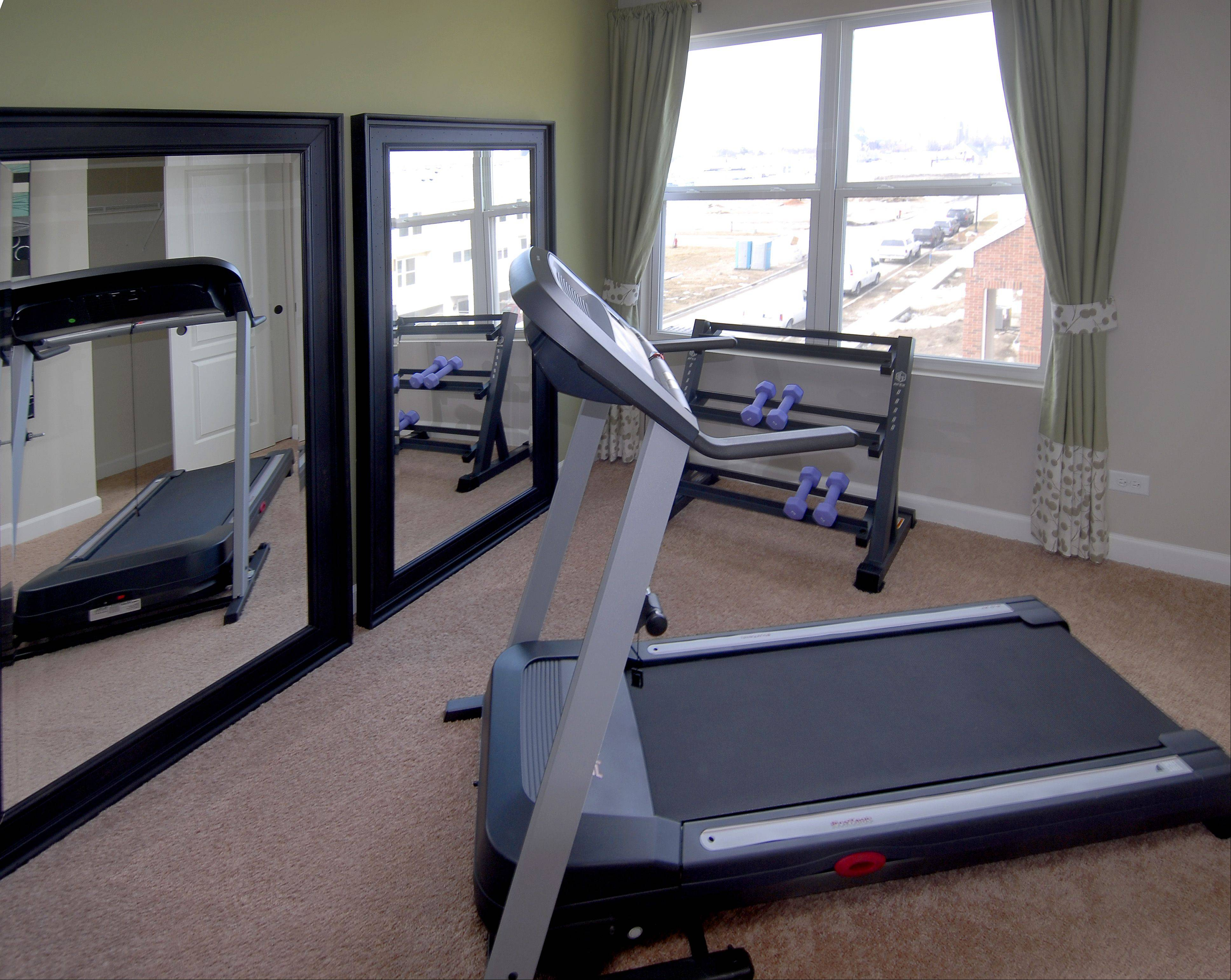 A spare bedroom in the Providence model at Arlington Crossings is furnished as a workout room.