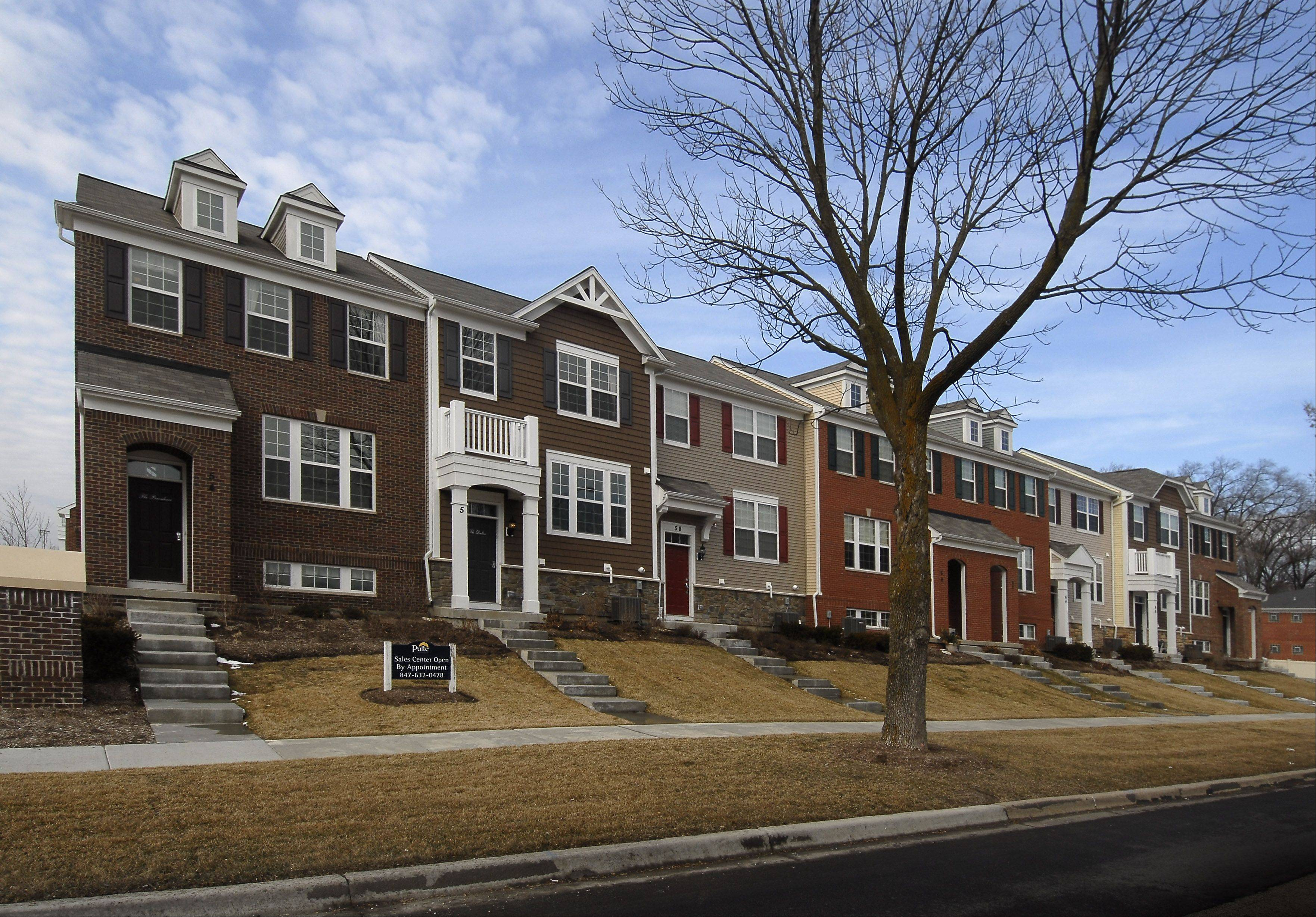 The Arlington Crossings row houses are located a block away from shopping and dining spots in Arlington Heights.