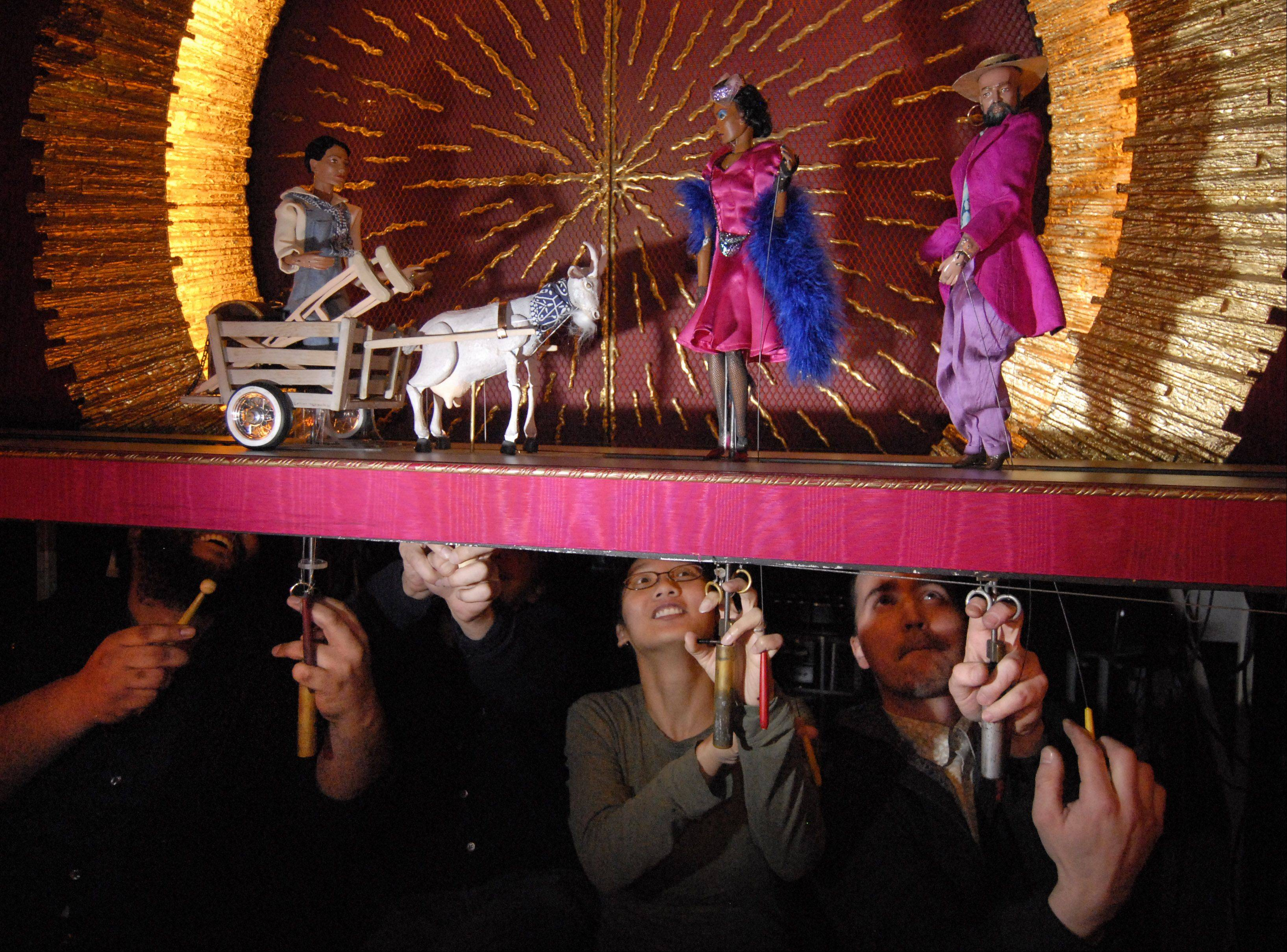 "Puppeteers operate puppets, including a goat, from a scene in ""Porgy and Bess"" at Opera in Focus in Rolling Meadows."