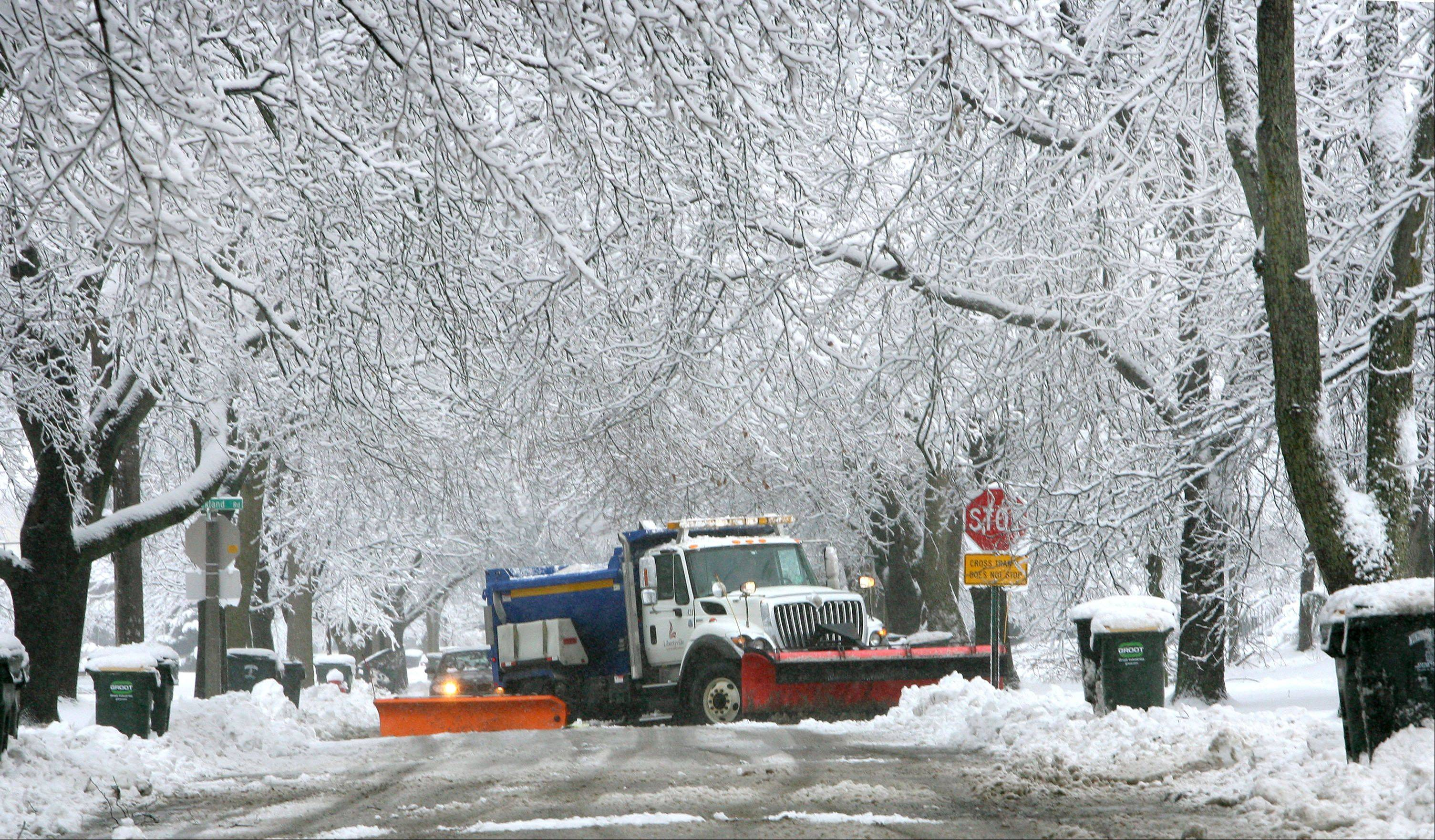A snowplow heads down Carter Street in Libertyville Friday morning after a winter storm dumped about 6 inches of snow on the area Thursday night.