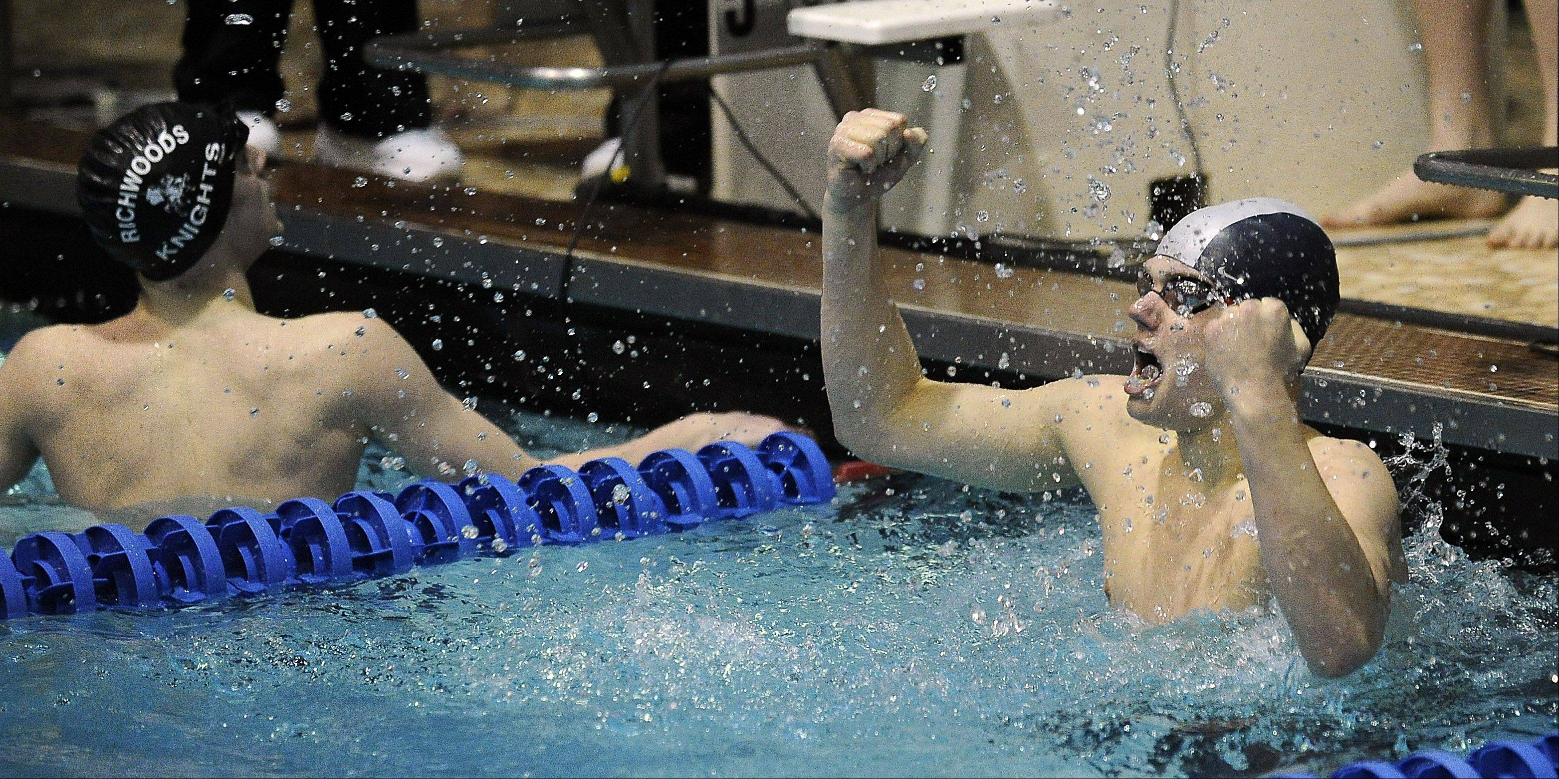 Mundelein's Art Kasemets celebrates his effort in the 100-yard breaststroke in the state swimming preliminaries at Evanston High School on Friday.
