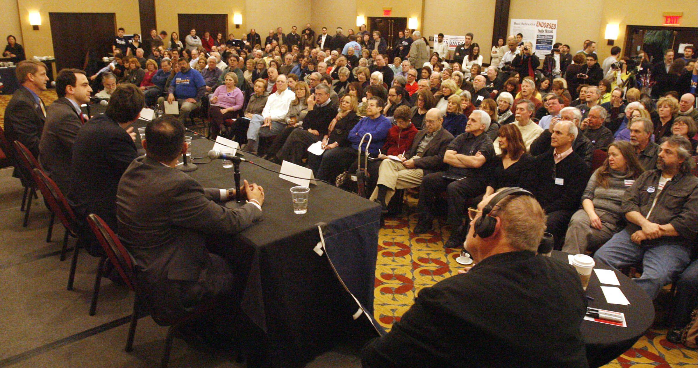 Democratic candidates for the 10th Congressional District, from left Vivek Bavda, Brad Schneider, Ilya Sheyman, and John Tree answer questions presented by WCPT radio host Dick Kay at a live forum Saturday at the Hyatt Deerfield.
