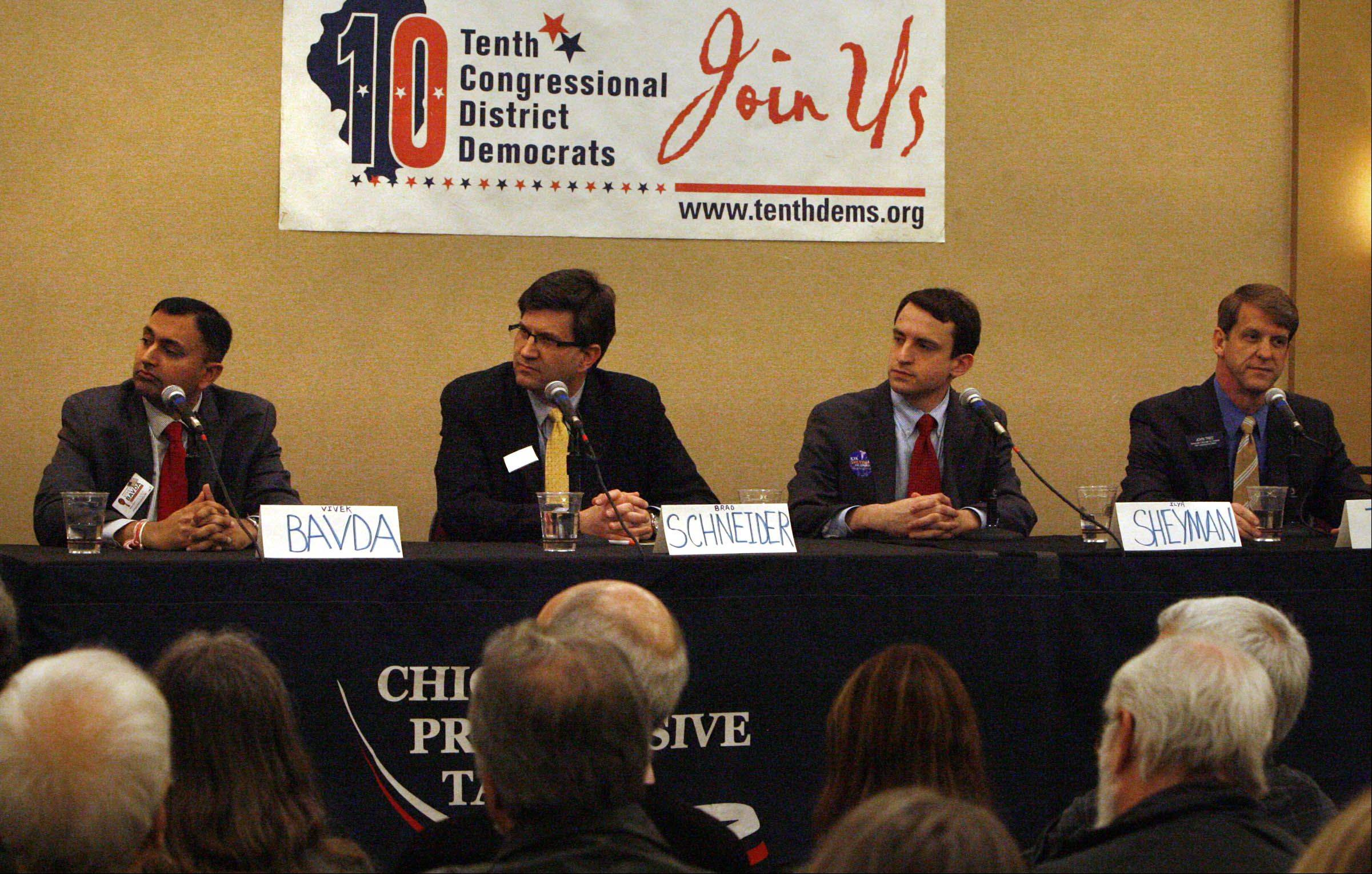 Democratic candidates for the 10th Congressional District, from left Vivek Bavda Brad Schneider, Ilya Sheyman, and John Tree answer questions presented by WCPT radio host Dick Kay at a live forum Saturday at the Hyatt Deerfield.