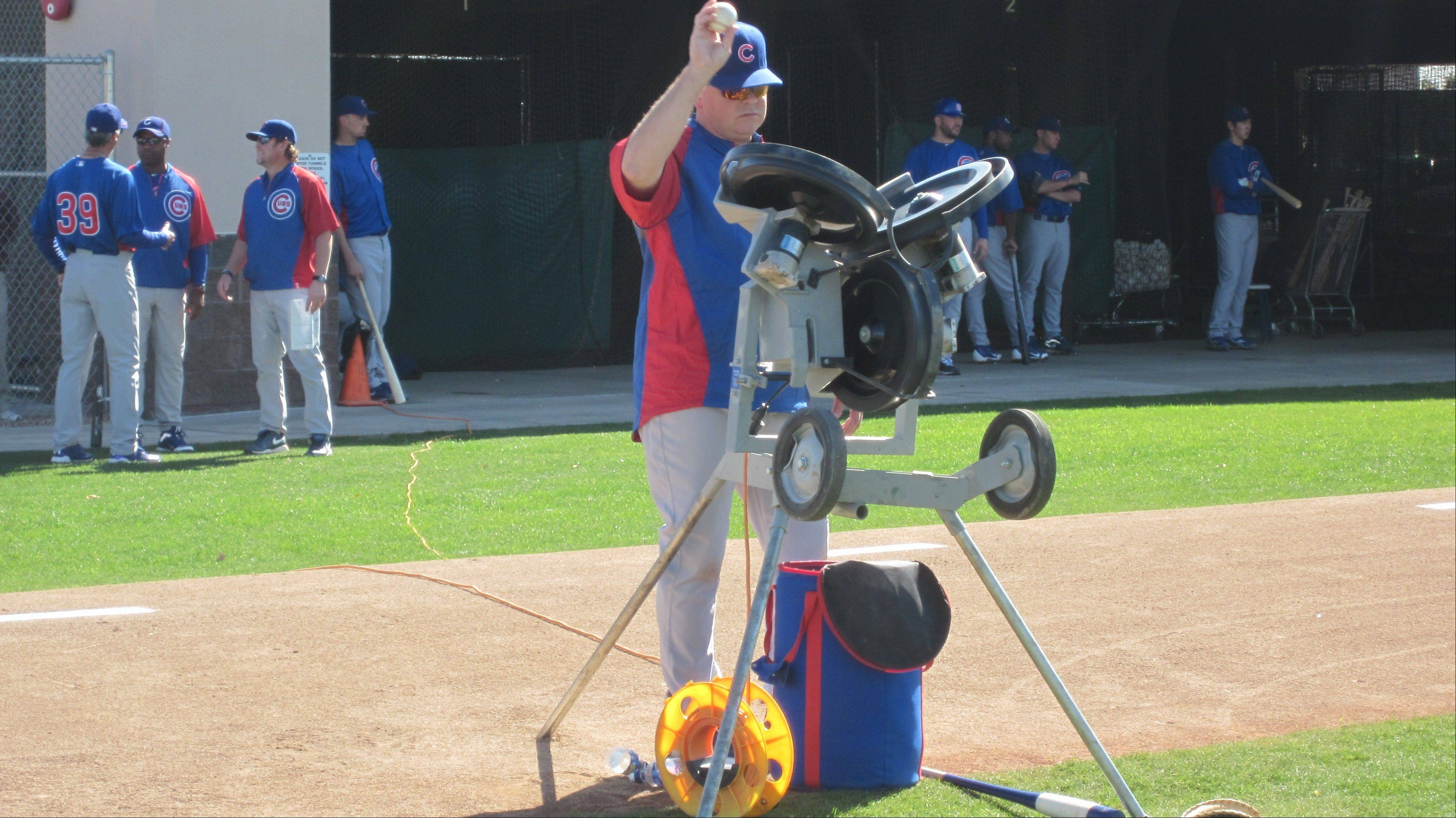 Marty Pevey runs the pitching machine to get in some extra work for Cubs catchers trying to handle tough pitches thrown in the dirt.