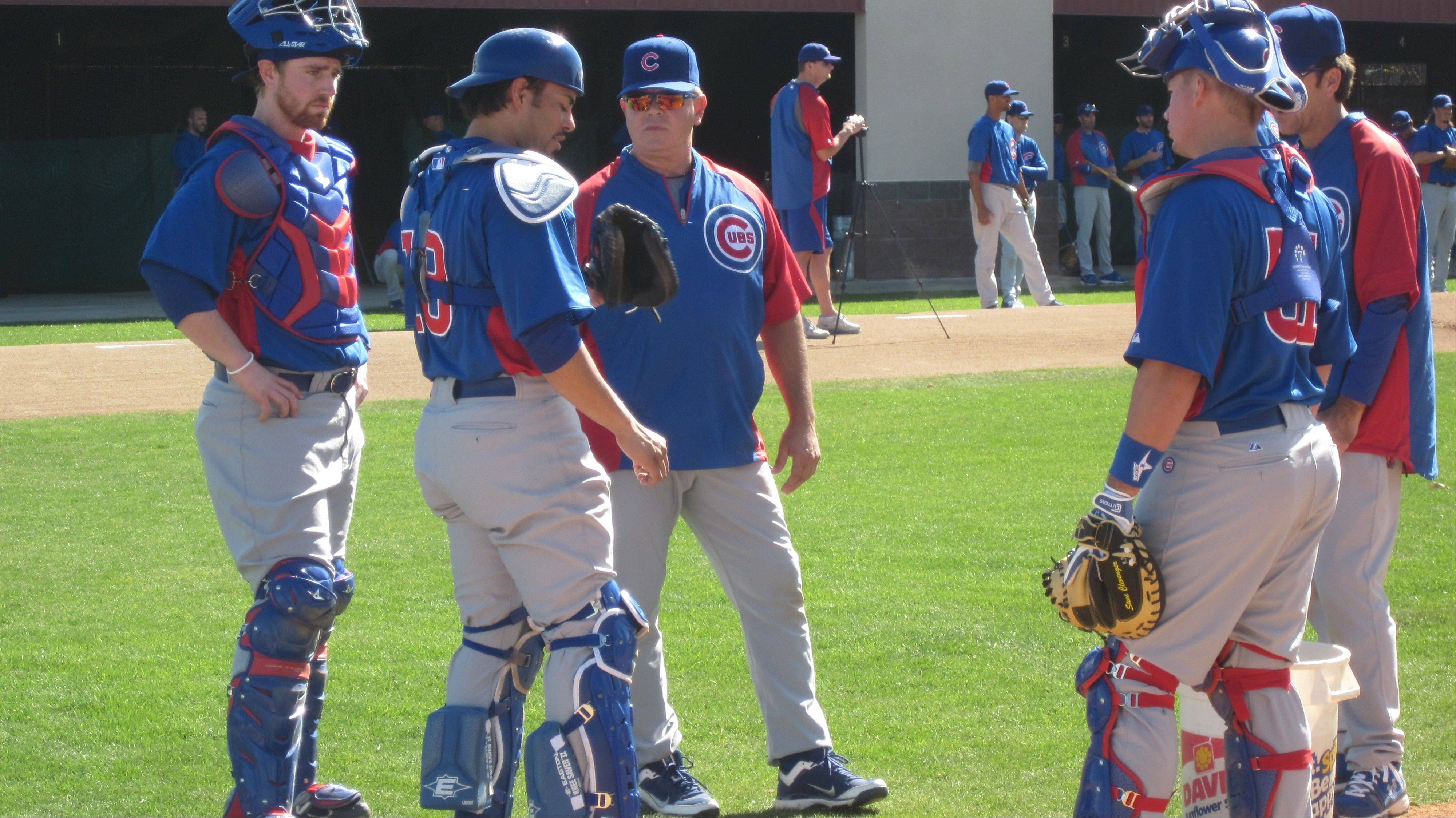 Cubs instructor Marty Pevey, center, has some advice for several catchers, including starter Geovany Soto (18) in spring training camp.