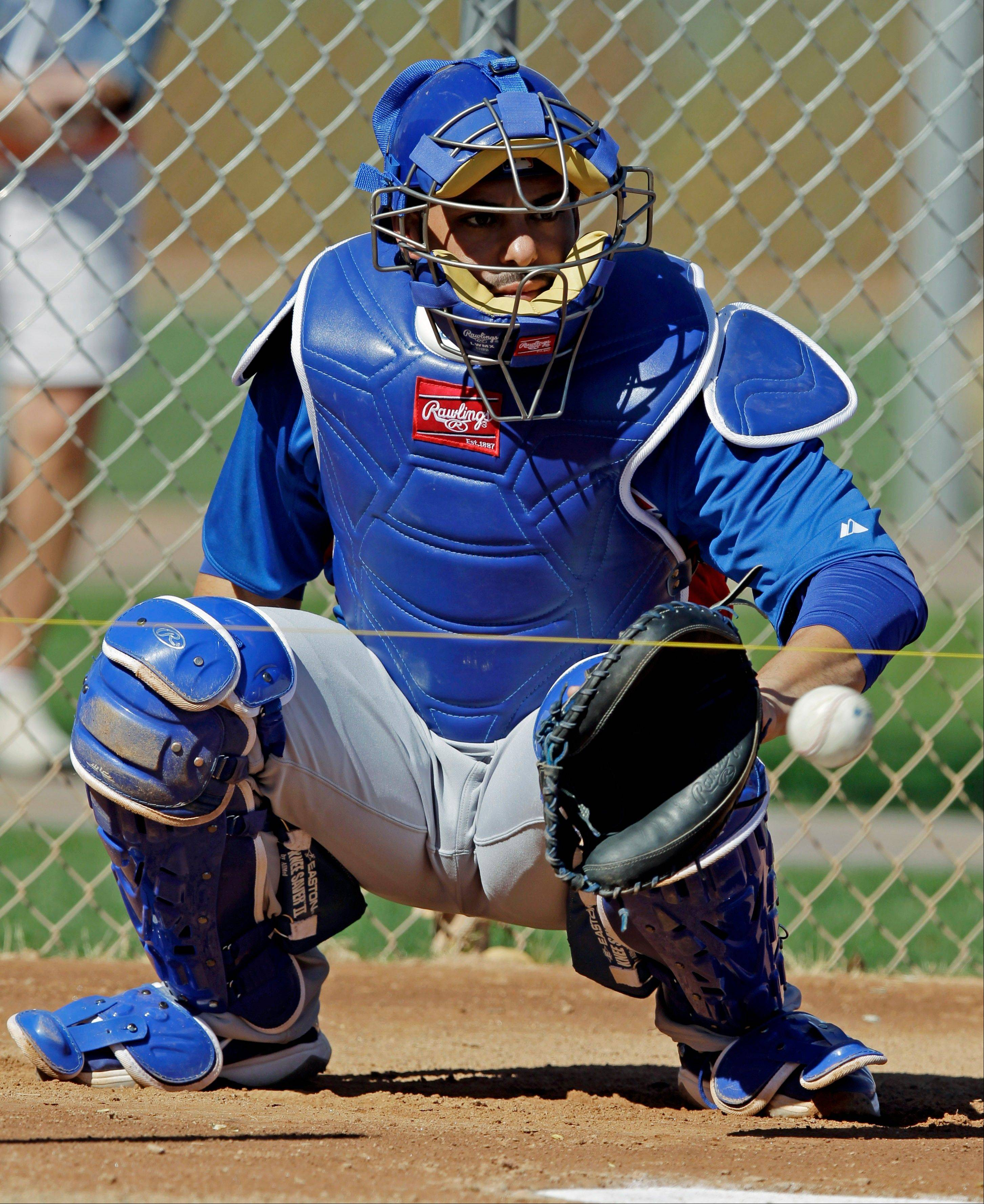 Cubs catcher Geovany Soto gets in some work in Mesa, Ariz., with some spring training drills.