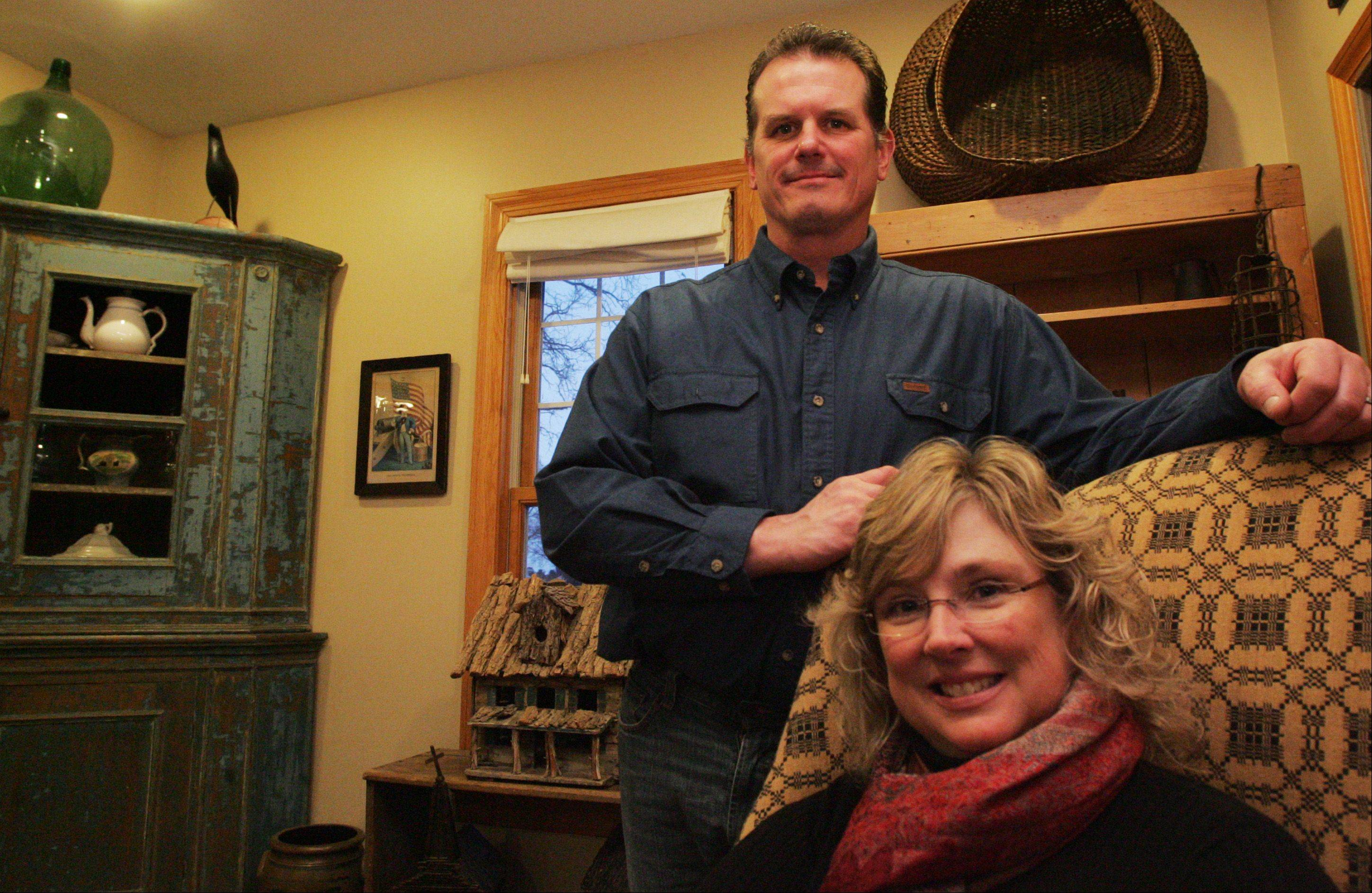Jim and Maureen Little of Kingston have filled their home with antiques collected near and far. Maureen says she likes the worn/functional look of the pieces in her home because they aren't just nice to look at. They get used as well.