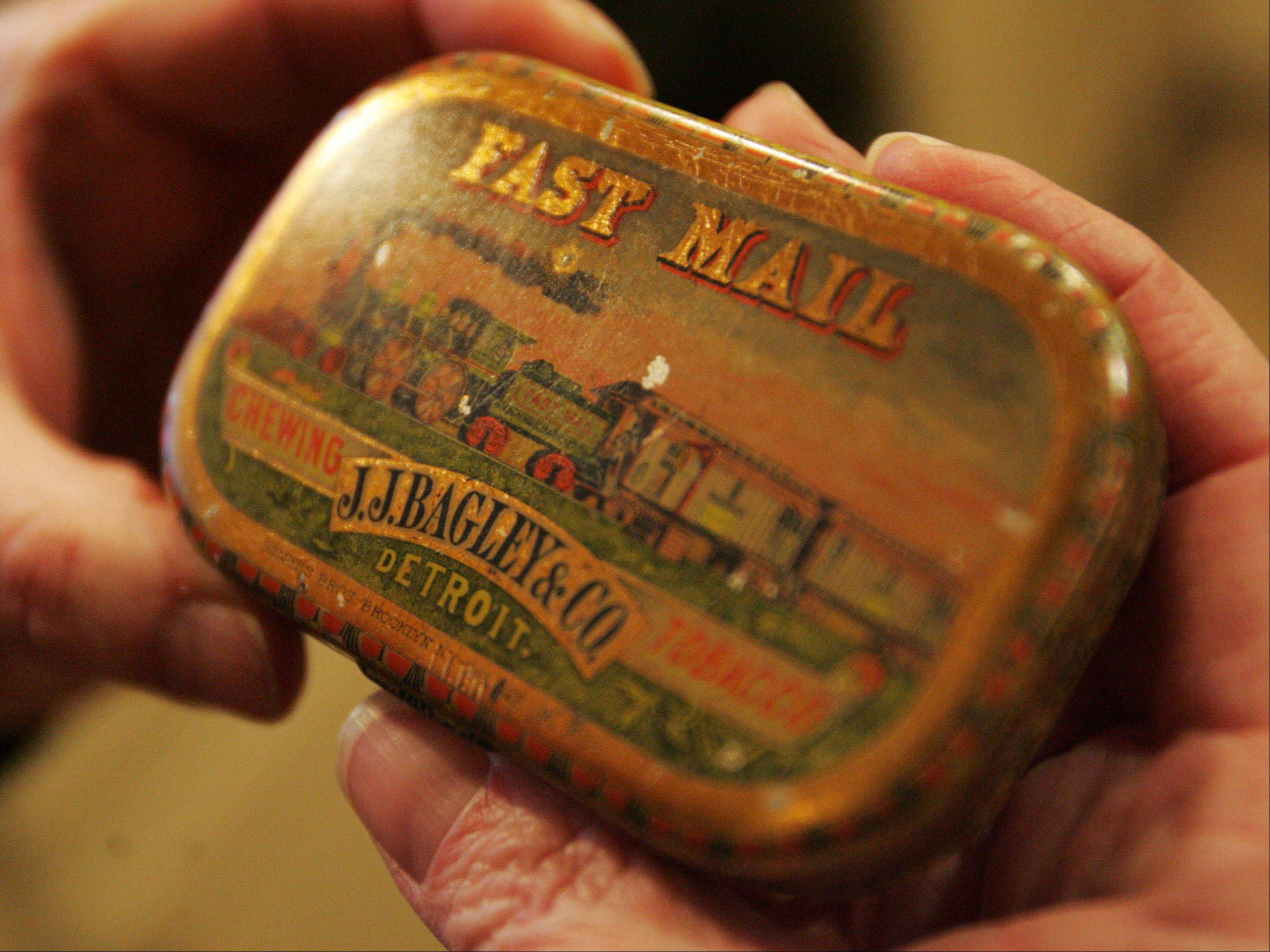 Jim and Maureen Little of Kingston collect antiques large and small. This is an old chewing tobacco container.