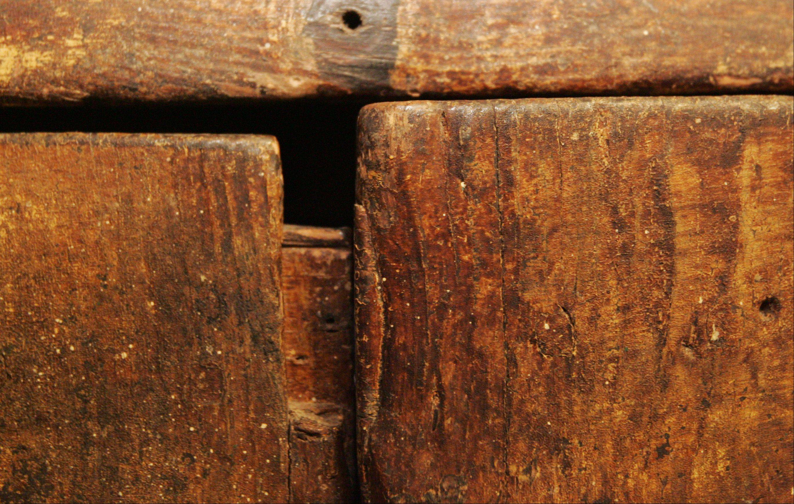 Much of the wooden furniture in the Little home bears signs of wear from the years of use, but that's just the way they like it.