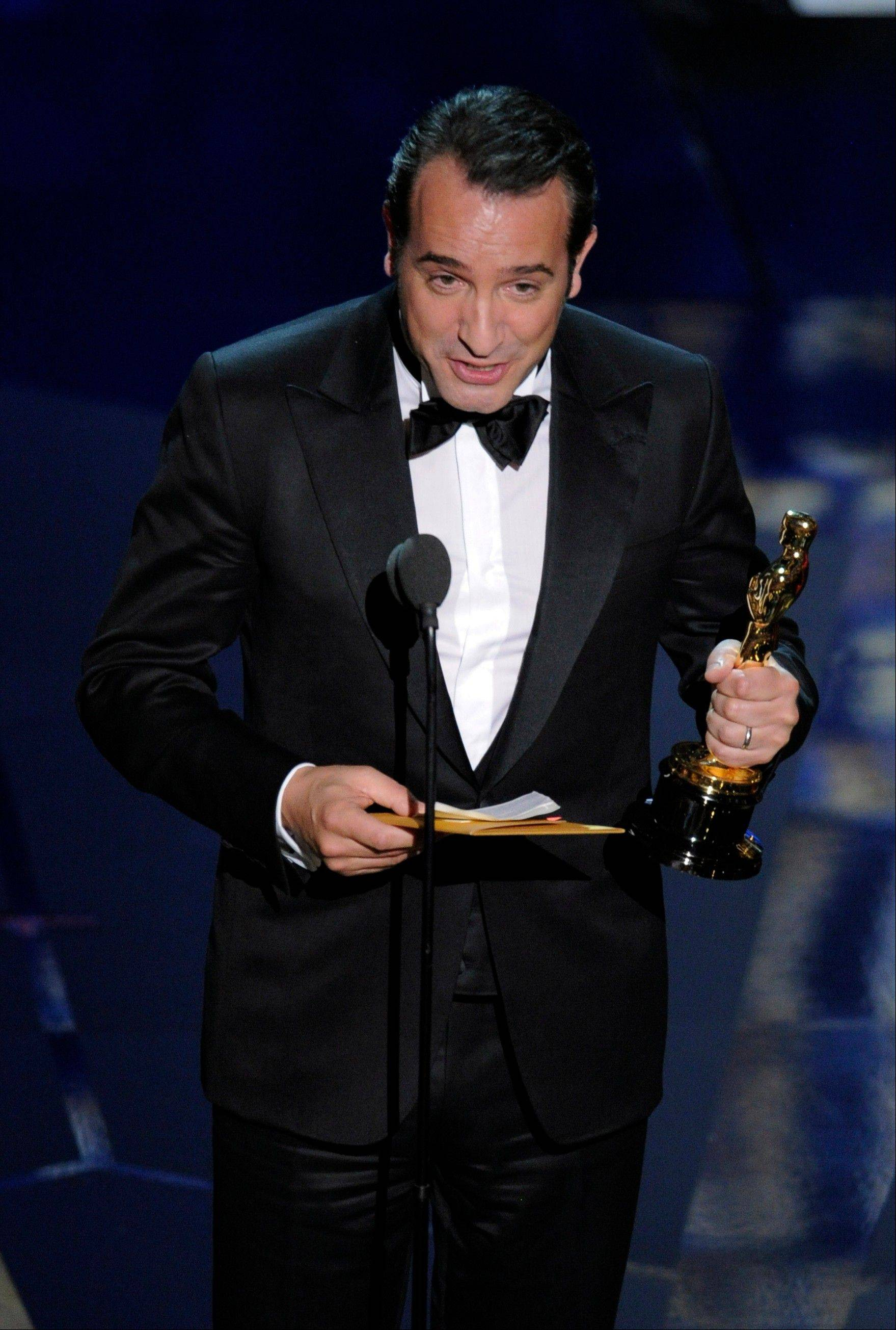 "Jean Dujardin accepts the Best Actor Oscar for ""The Artist."""