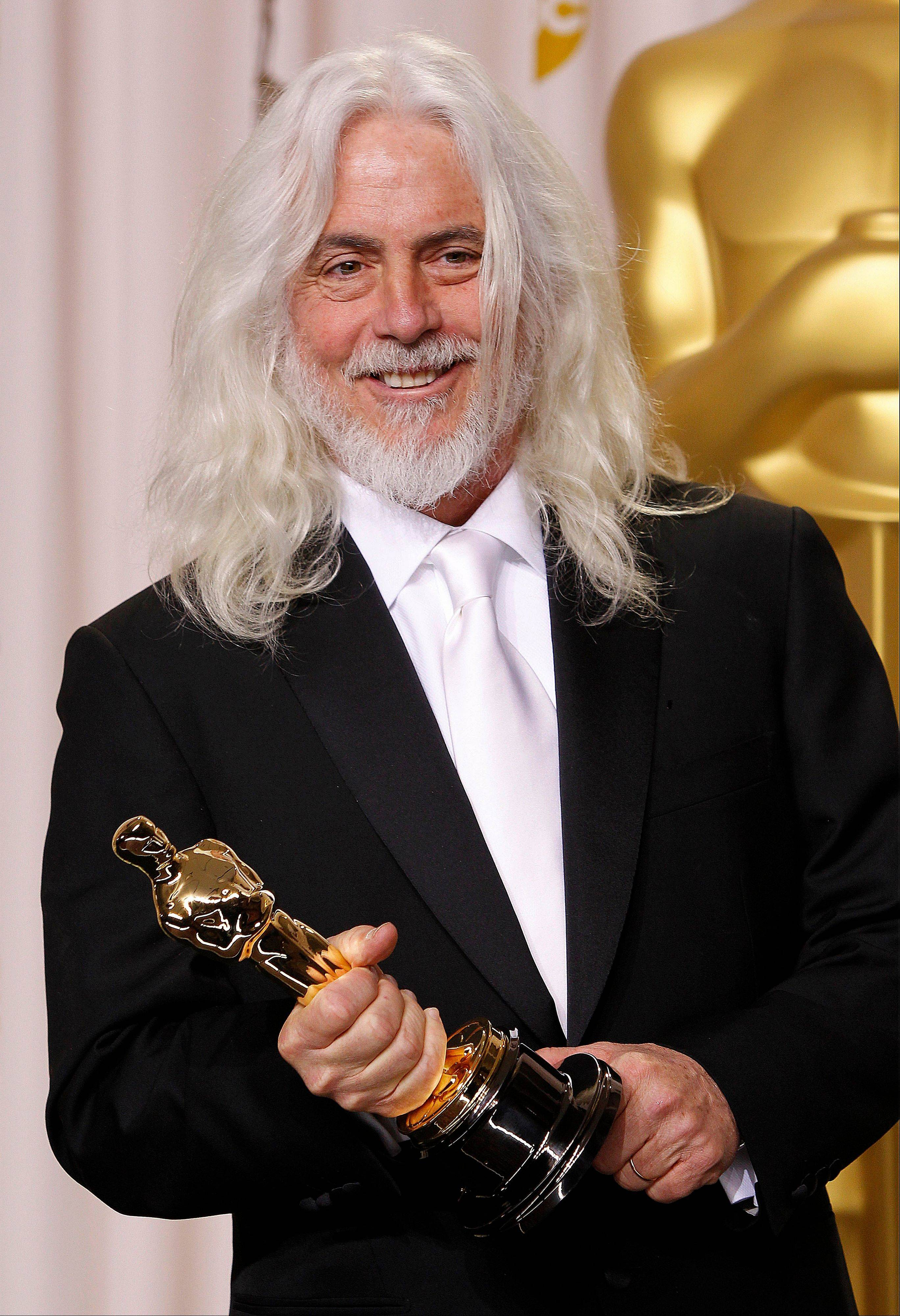 "Robert Richardson poses with his award for Best Cinematography for ""Hugo."""