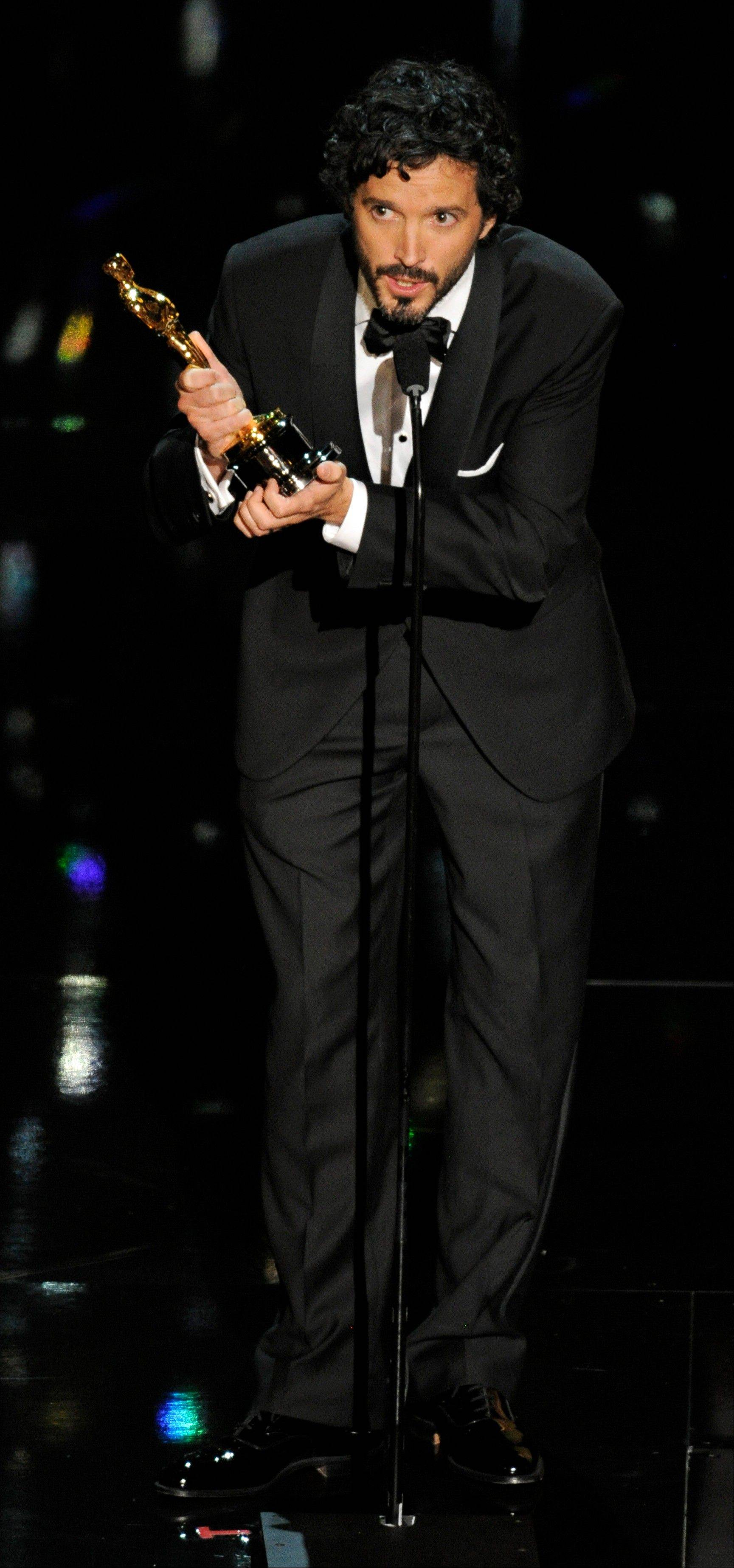 "Bret McKenzie accepts the Oscar for Best Original Song for ""Man or Muppet"" from ""The Muppets."""