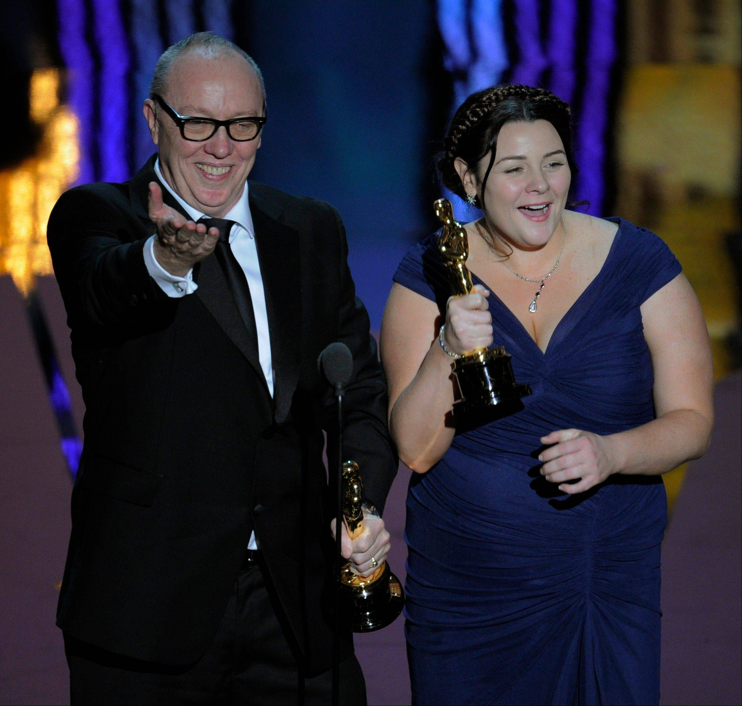 "Terry George and Oorlagh George accept the Oscar for Best Live Action Short Film for ""The Shore."""