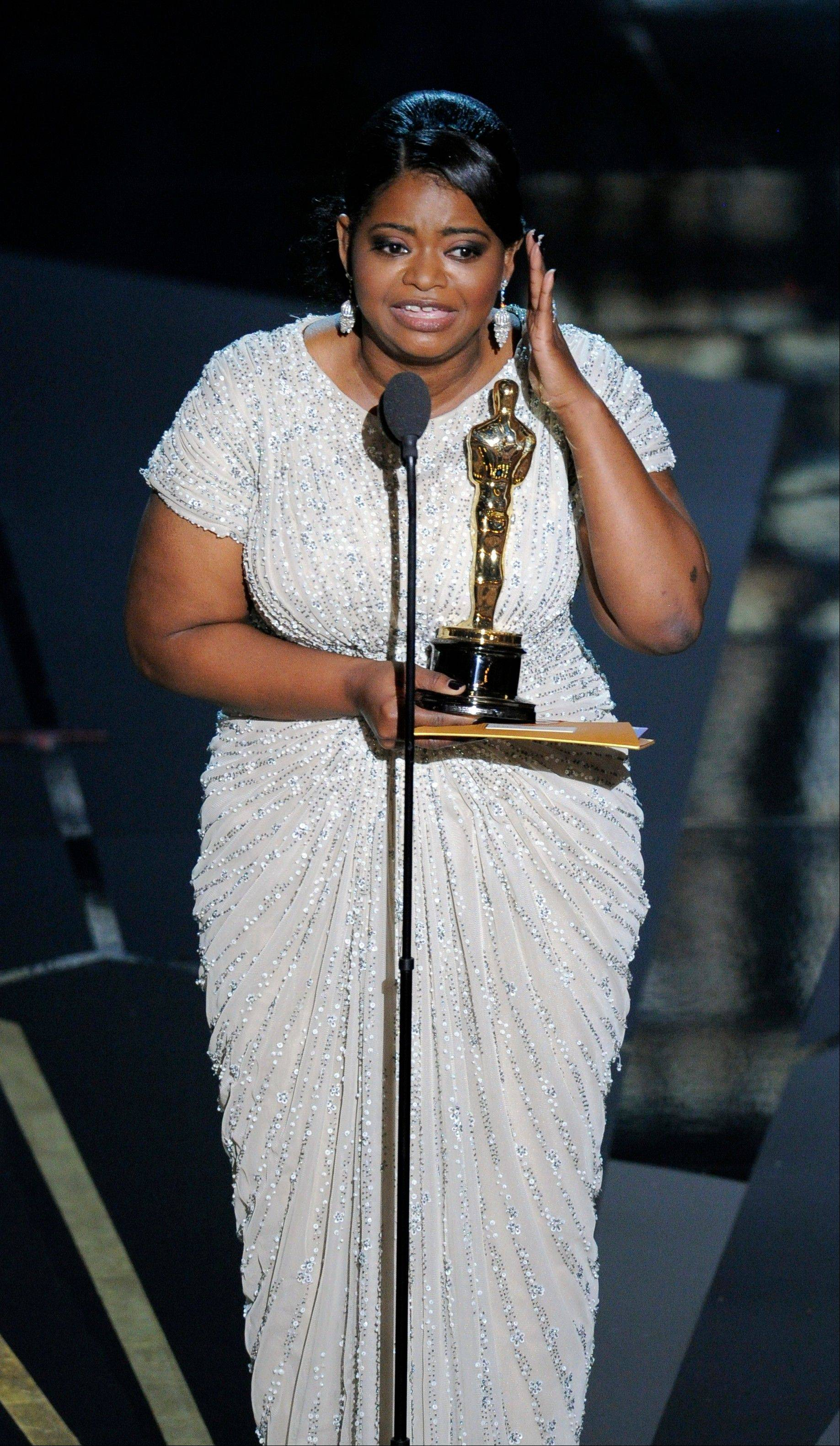"Octavia Spencer accepts the Oscar for Best Supporting Actress for ""The Help."""