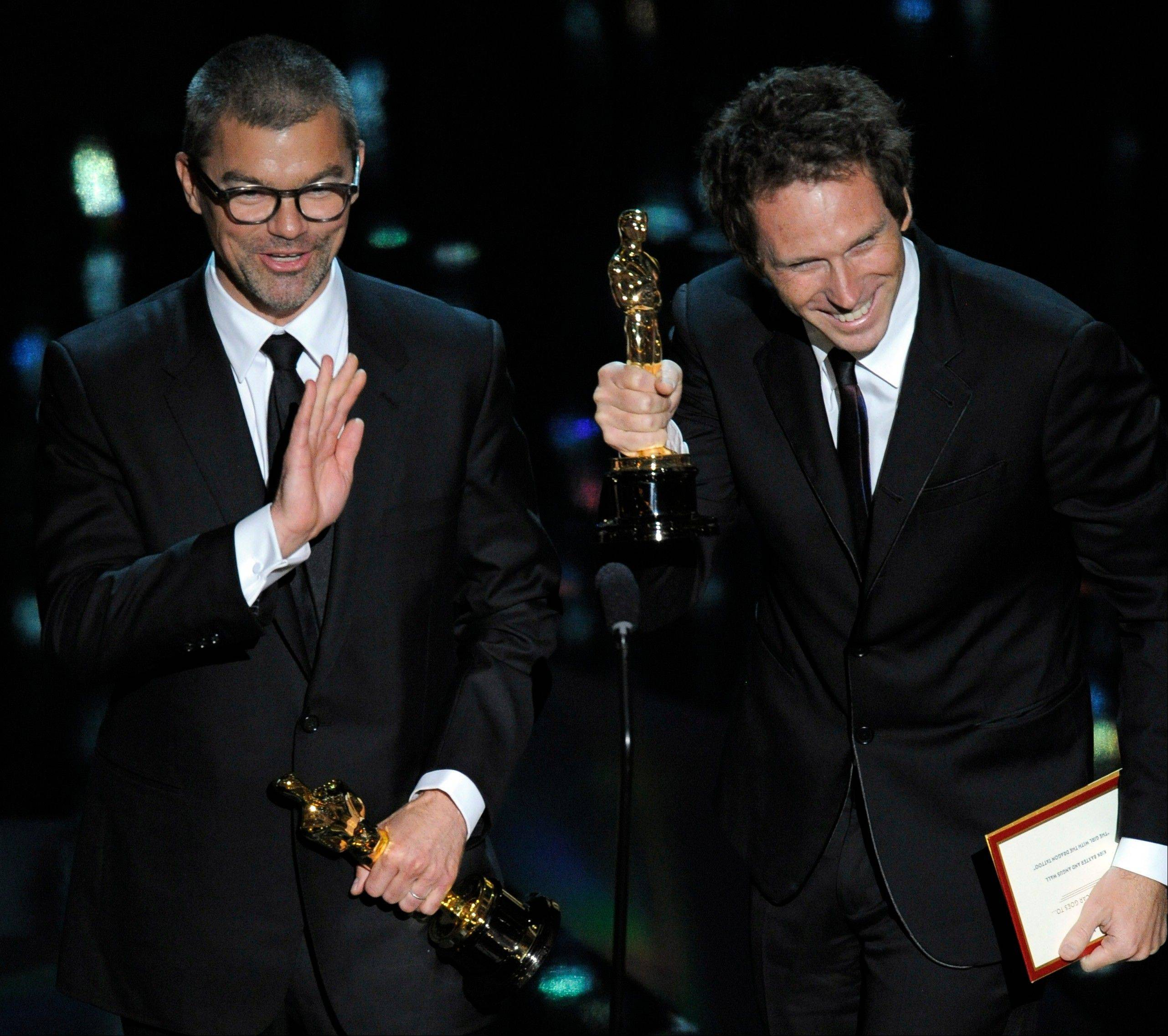 "Kirk Baxter and Angus Wall accept the Oscar for Best Film Editing for ""The Girl with the Dragon Tattoo."""