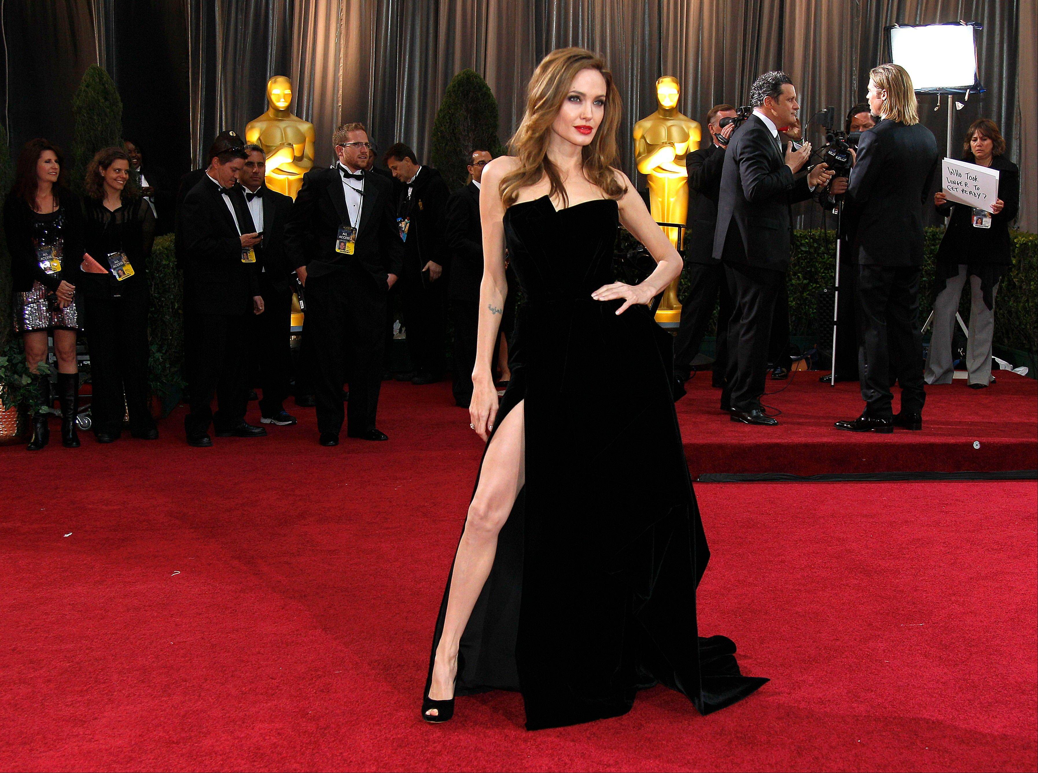 Actress Angelina Jolie shows some leg in her Atelier Versace dress.