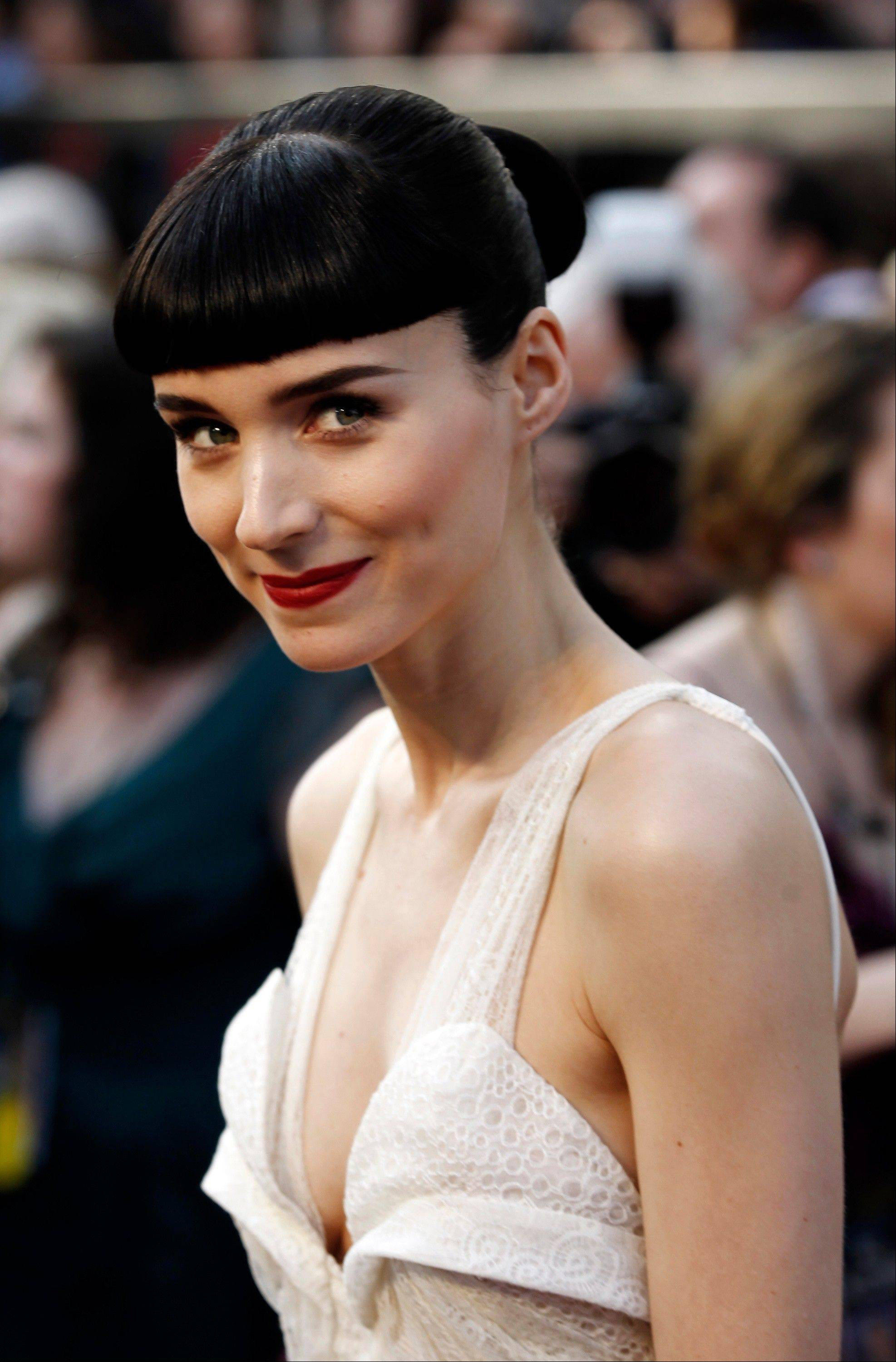 "Rooney Mara, star of ""The Girl with the Dragon Tattoo,"" cuts a sleek figure as she arrives for the 84th Academy Awards on Sunday in Hollywood."