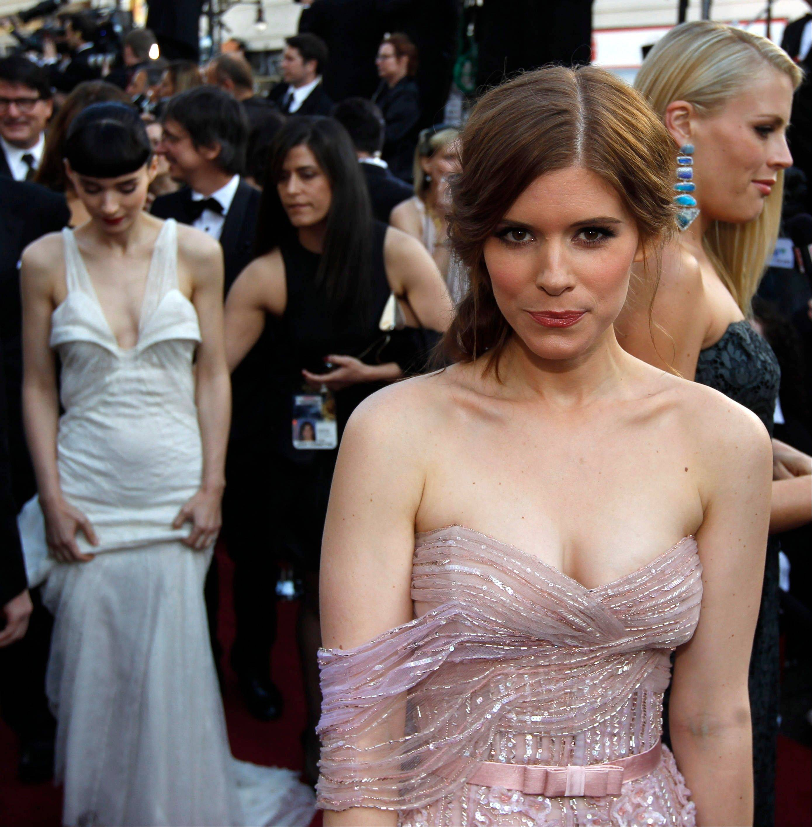Kate Mara arrives doe the 84th Academy Awards on Sunday. In background at left is her sister Rooney Mara.