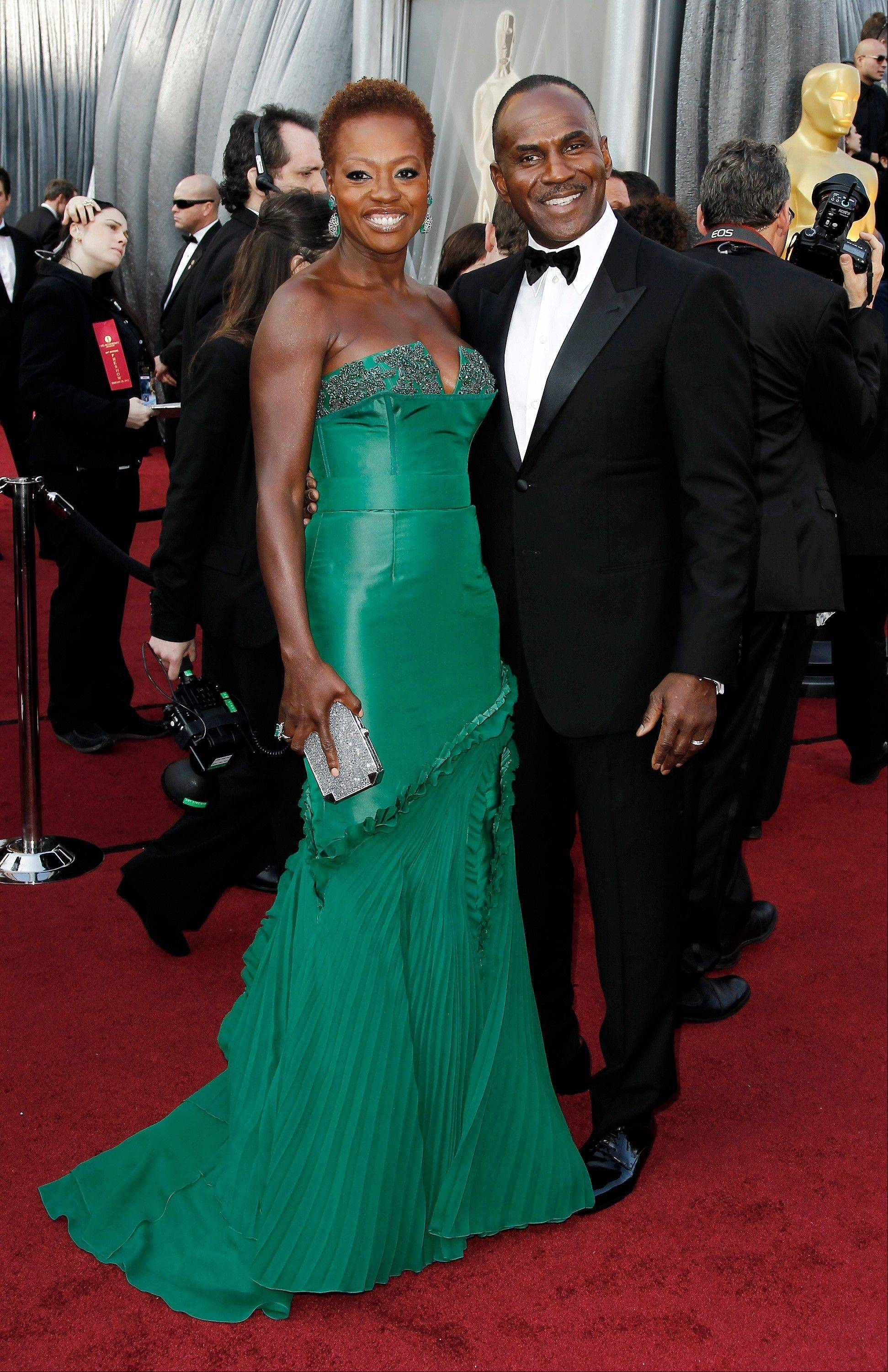 Nominee Viola Davis, wearing Vera Wang, and Julius Tennon arrive for the Oscars.