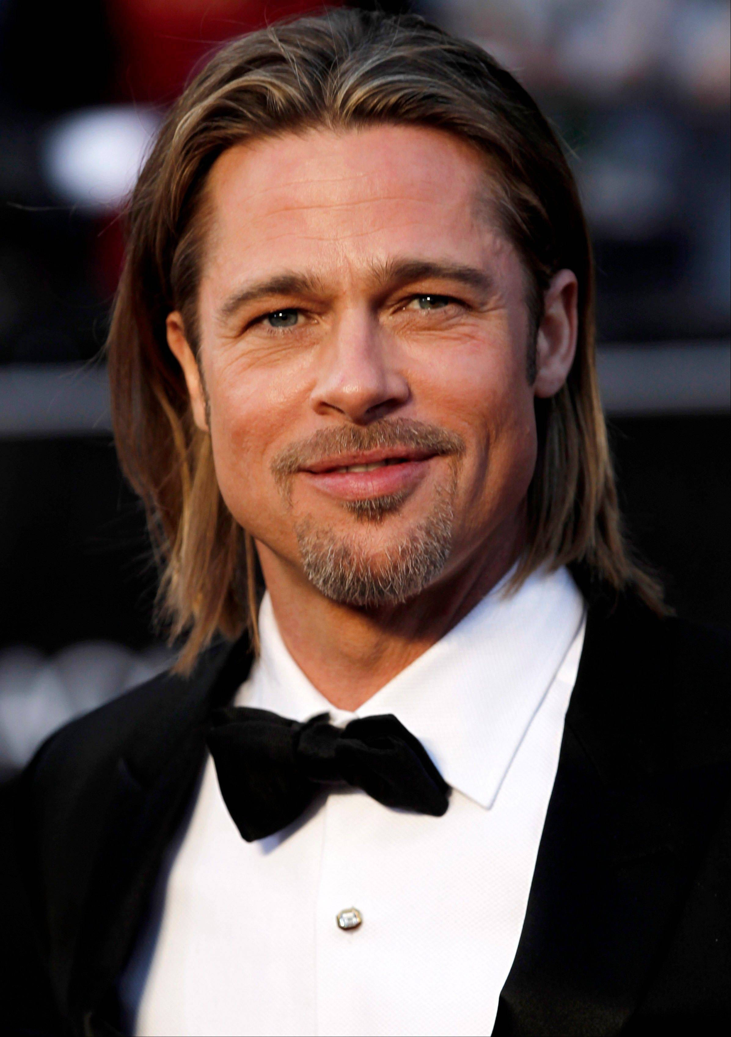 Academy Award nominee Brad Pitt arrives at the Oscars.