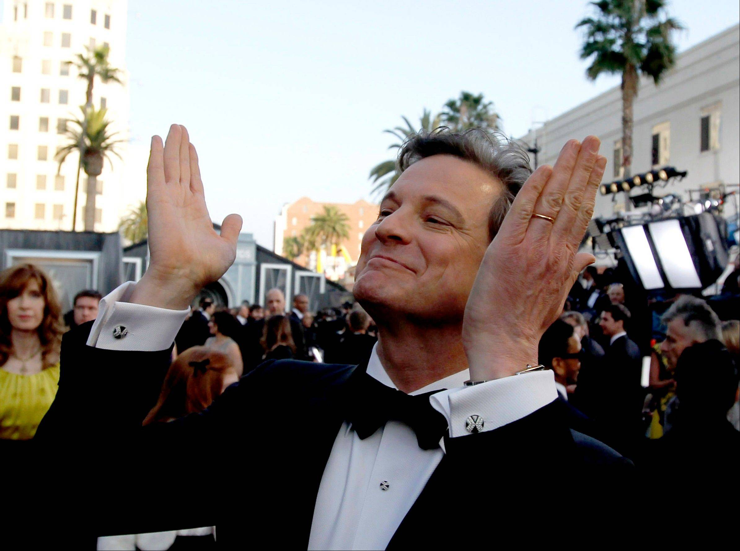 The debonair Colin Firth greets fans on the red carpet.