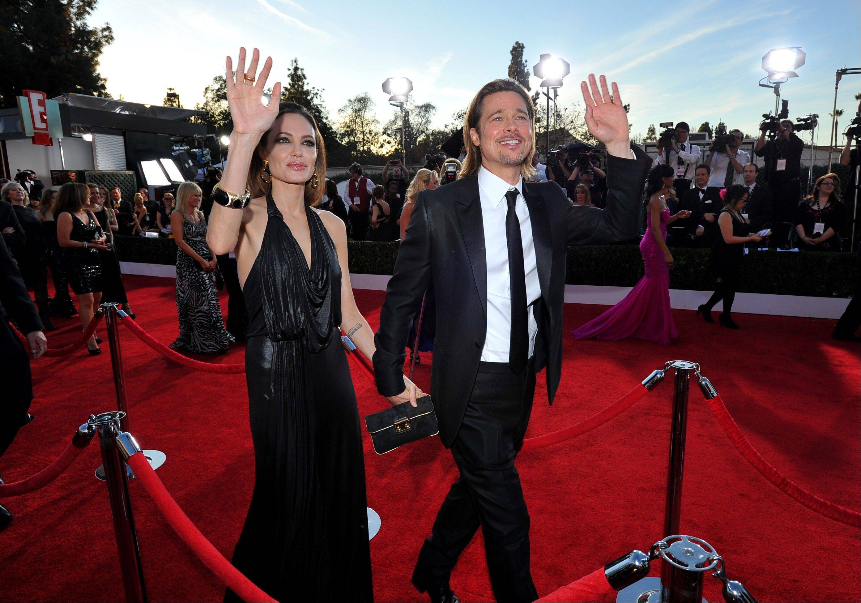 Angelina Jolie and Brad Pitt arrive on the red carpet at the 18th Annual Screen Actors Guild Awards last month in Los Angeles. Their Oscar arrival will be a big deal as well.