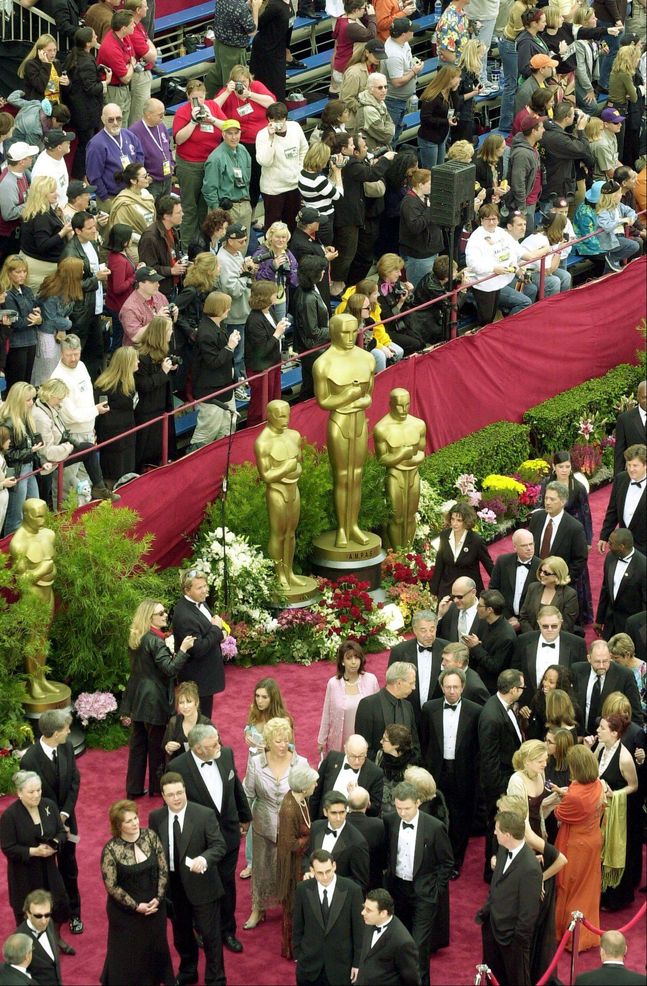 Celebrities will stroll down the red carpet past fans, en route to the Academy Awards show.