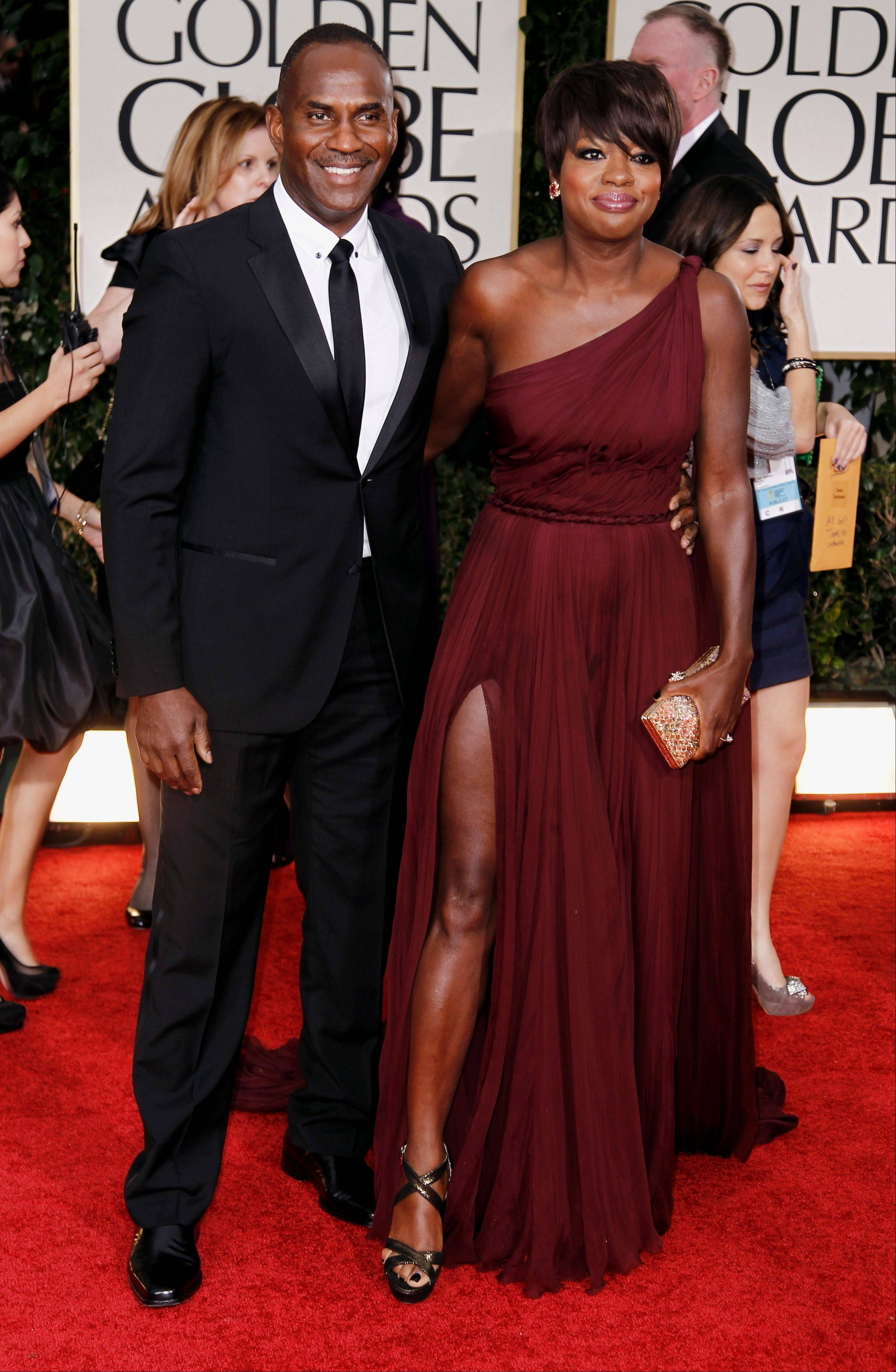 "Sasha Charnin Morrison, fashion director for US Weekly magazine, says to ""expect something very colorful and very beautiful"" from Viola Davis, shown arriving at the Golden Globe Awards last month, at Sunday's Oscars."