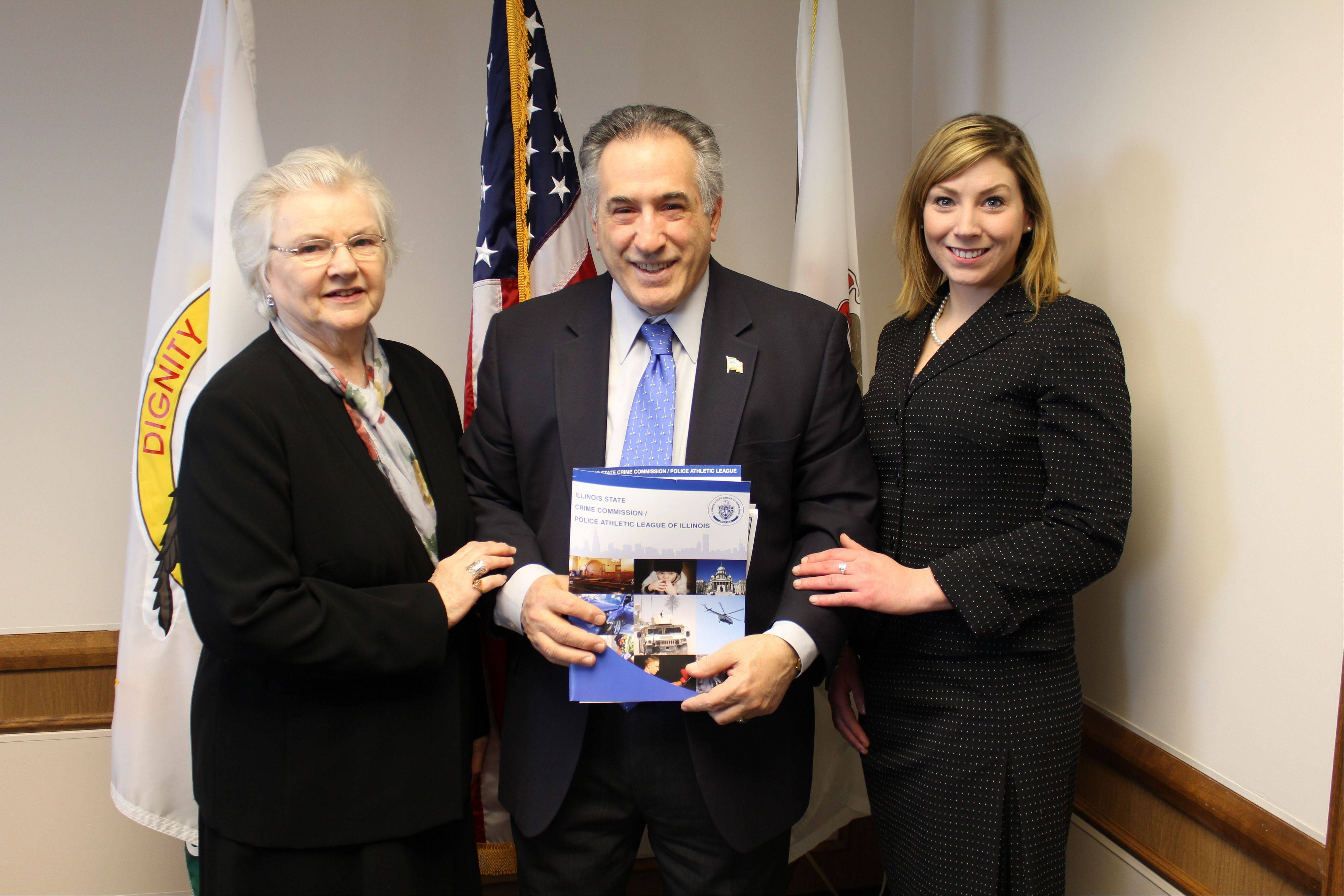 "Des Plaines Mayor Marty Moylan will be receiving the 2012 ""Municipal Leader of the Year"" award from the Illinois State Crime Commission Police Athletic League of Illinois. Pictured here, Moylan gets congratulations from Wanda Brunke, left, and Sarah Elsner, both special events coordinators for the Illinois State Crime Commission."
