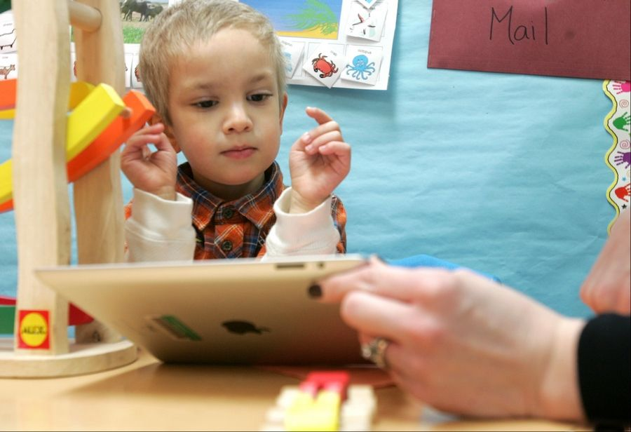Reco Capparelli, 3, of Wheaton, uses an iPad during a speech therapy session at Jefferson Preschool with speech pathologist Nicole MacKinnon.