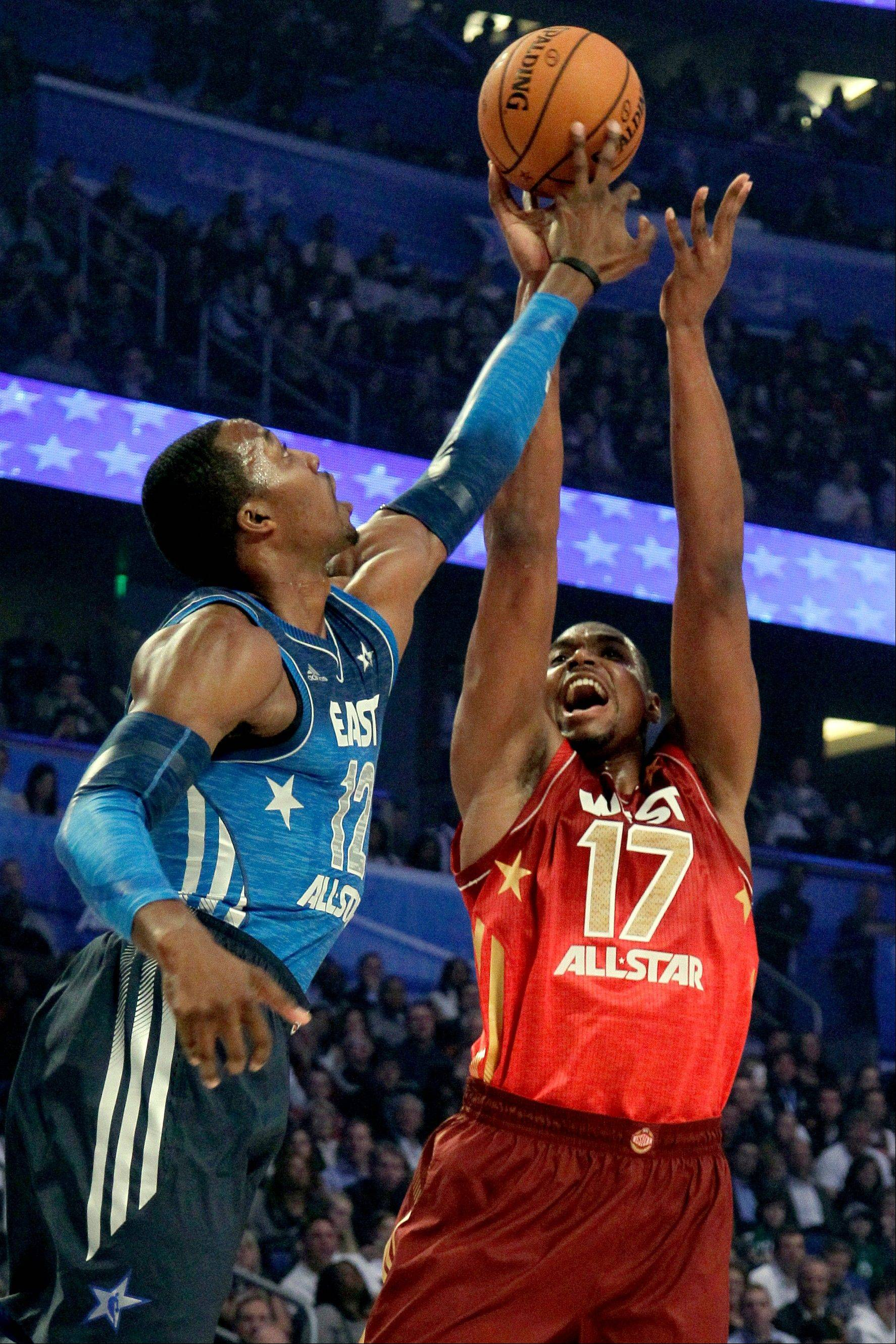 Dwight Howard, of the Orlando Magic, blocks a shot by Andrew Bynum, of the Los Angeles Lakers, during the NBA All-Star Game on Sunday in Orlando, Fla. Bynum's West squad prevailed 152-149. See story, Page 3.