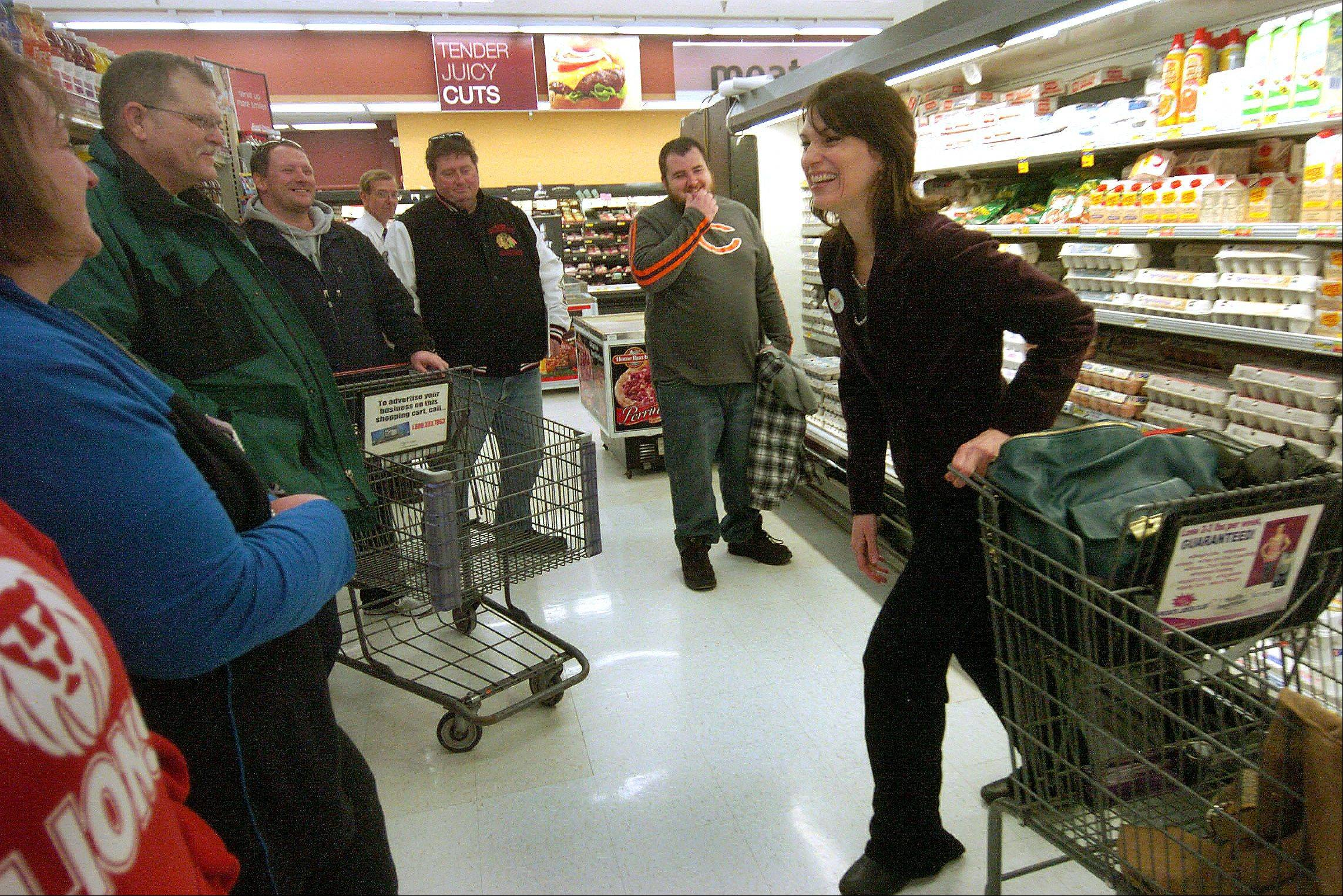 Dietitian Kimberly Kirchherr shows the Fittest Loser contestants some healthy food choice options at Jewel-Osco in Schaumburg.