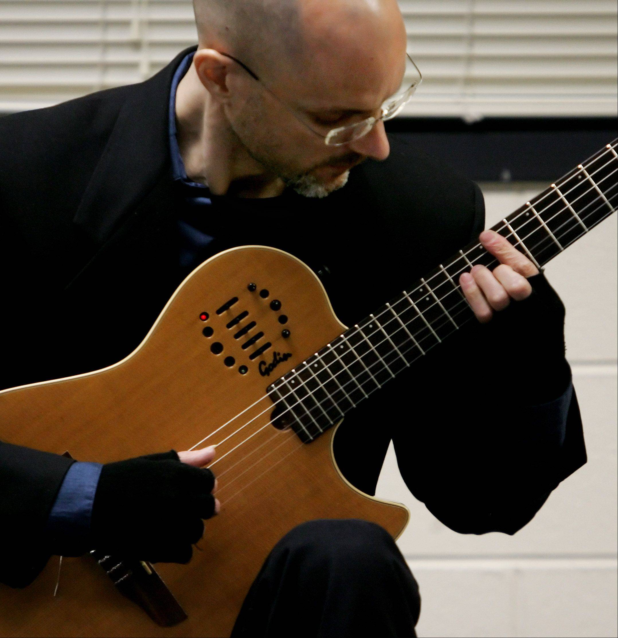 Guitarist Joseph Loban performs in the Flamenco Guitar class during the Odyssey Fine Arts Festival at Stevenson High School in Lincolnshire. The two-day event brings in writers, performers and artists to broaden the exposure of the arts for students.