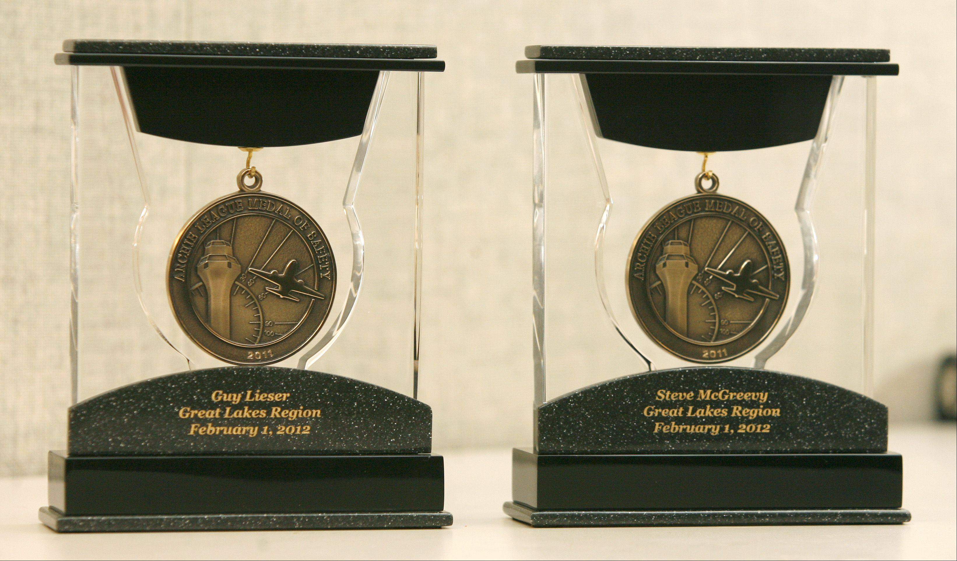 Steve McGreevy and Guy Lieser, who maneuvered a distressed pilot safely to the ground from the Air Route Traffic Control Center in Aurora, received the prestigious Archie League Medal of Safety Award for their efforts.