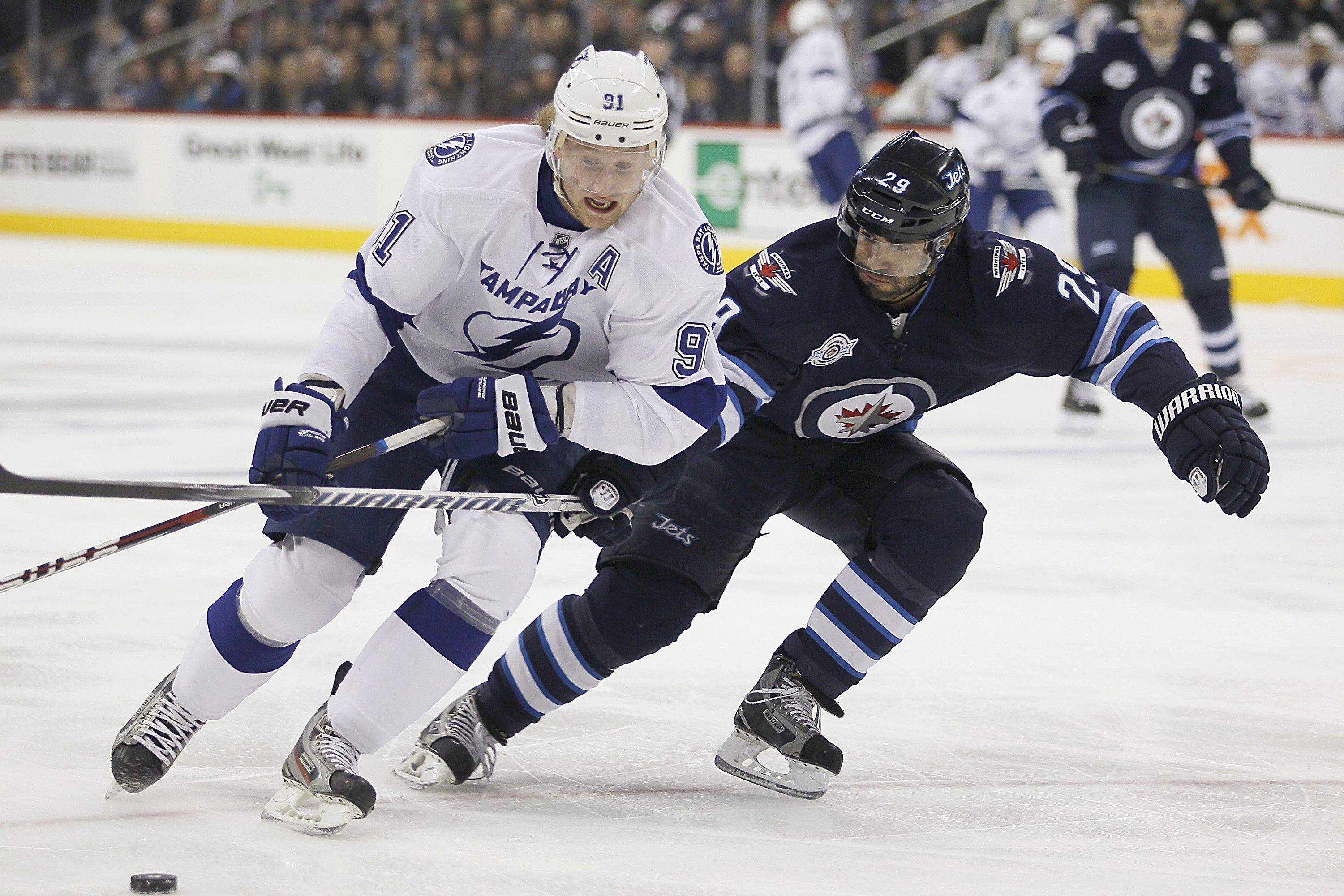 The Blackhawks acquired Winnipeg defenseman Johnny Oduya, right, before Monday's NHL trade deadline. He is considered a solid defenseman and a good stick handler.
