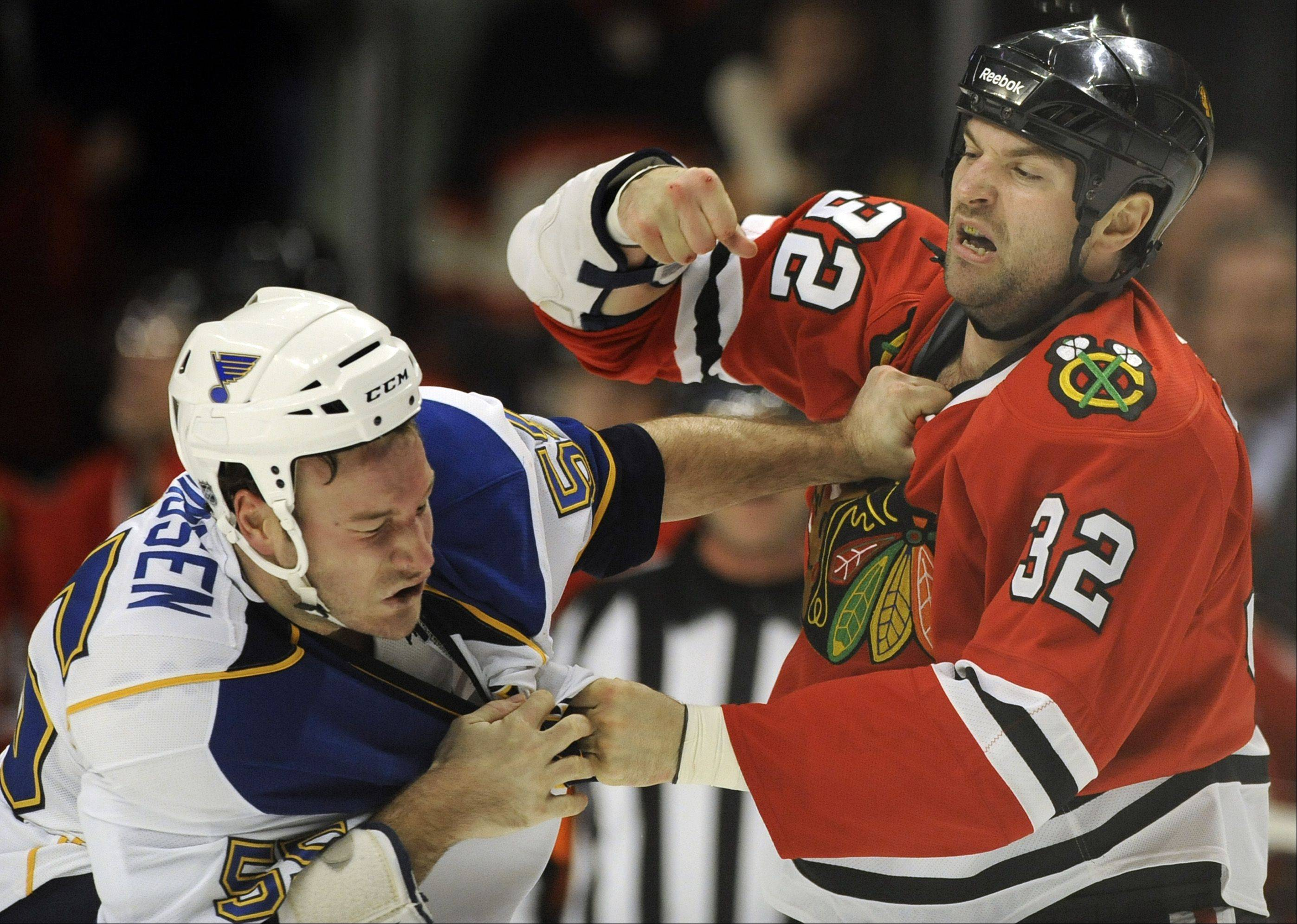 To help clear a roster spot, the Blackhawks traded defenseman and enforcer John Scott, right, to the New York Rangers for a fifth-round draft pick.