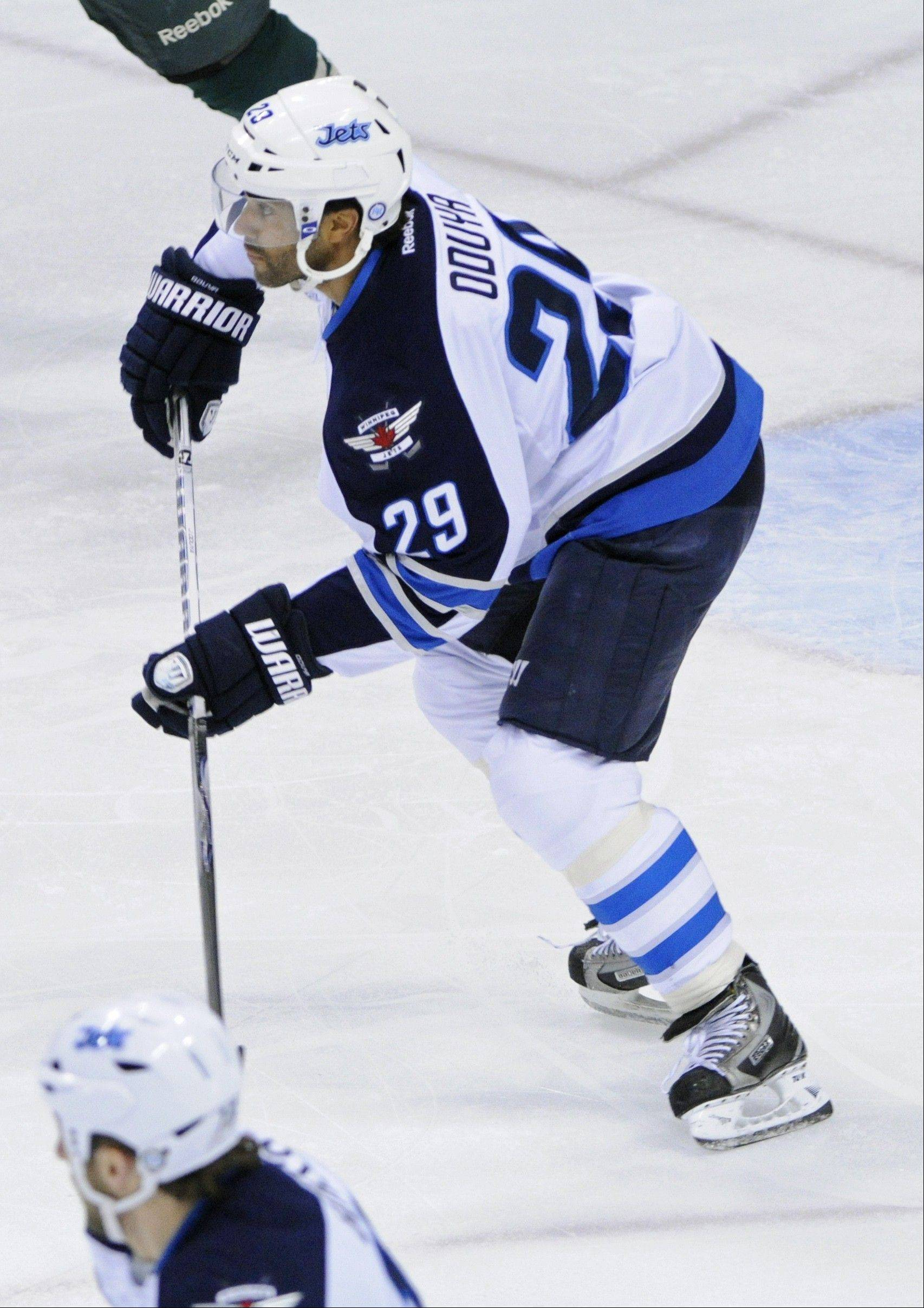 Winnipeg Jets' Johnny Oduya, a defenseman from Sweden, will join the Blackhawks after they acquired him in a trade for draft picks Monday.