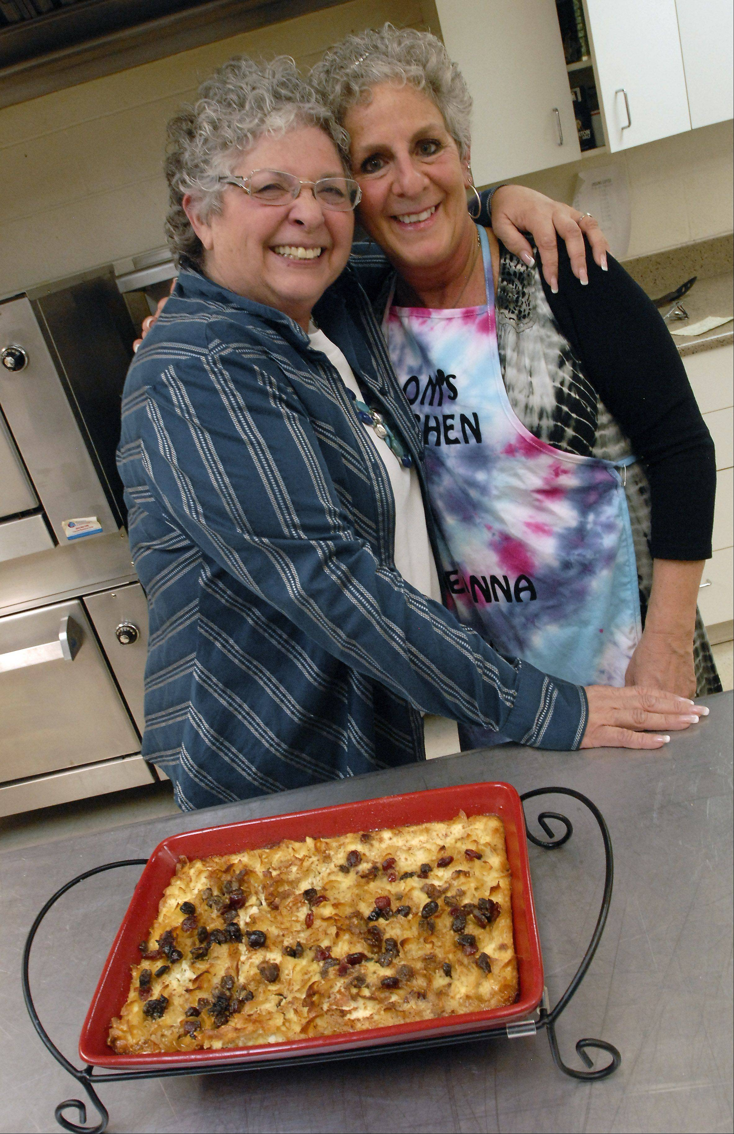 Roberta Fahey, right, gets a hug from helper Gloria Katz in the kitchen at Beth Tikvah Early Childhood Center in Hoffman Estates where Fahey cooks each week for the students and teachers.